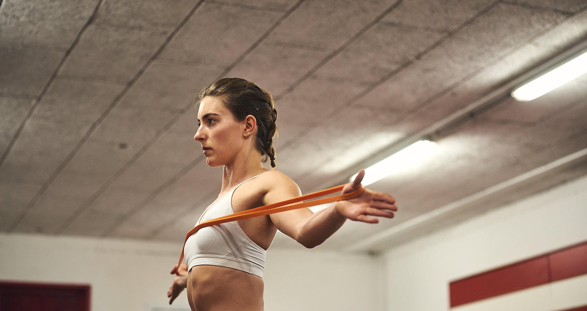 Bianca Baak stretching in a gym