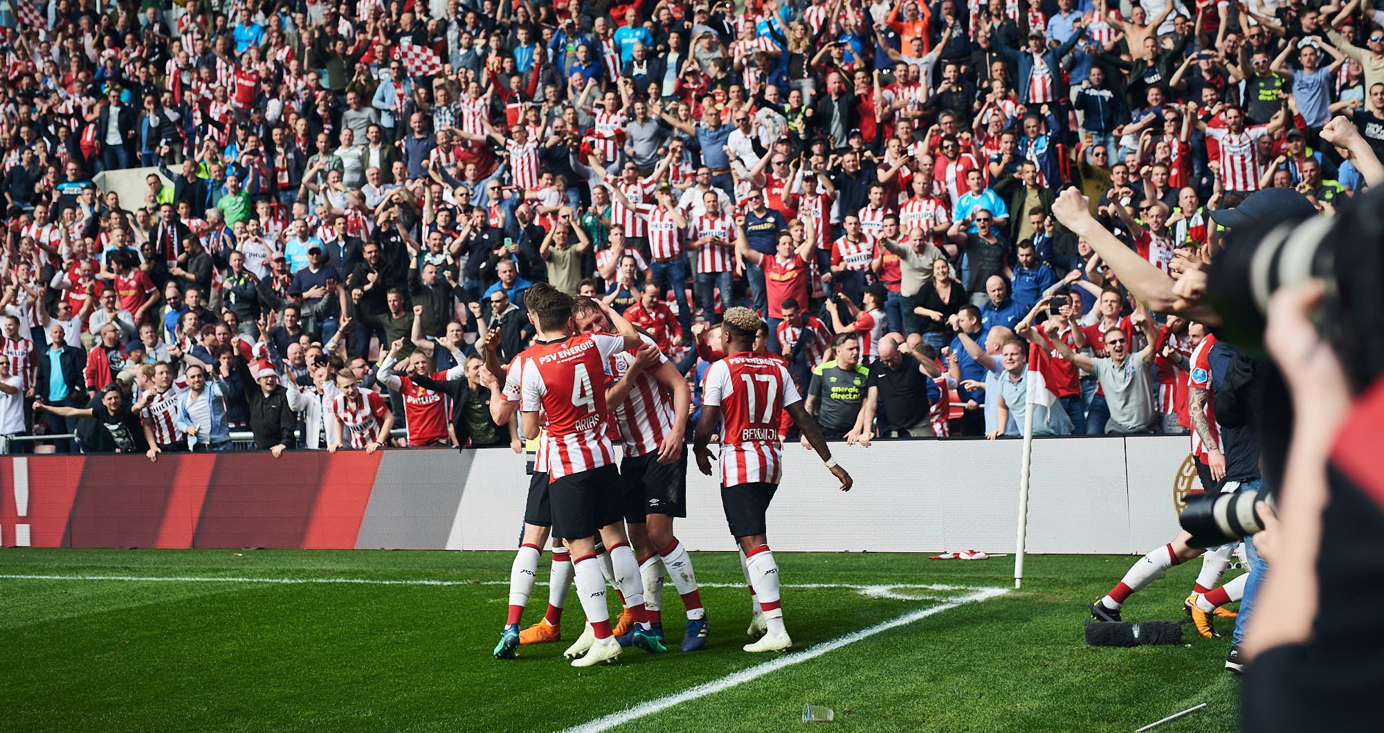 PSV football players celebrating a goal against Ajax