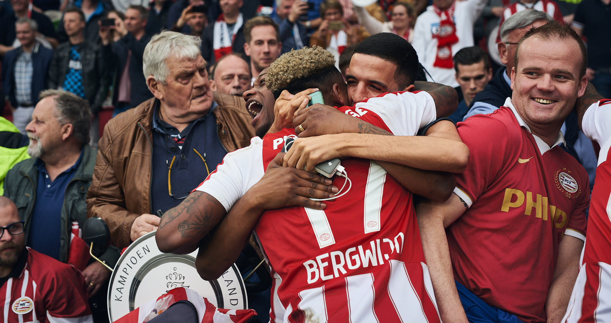Football player Steven Bergwijn embraces family during PSV Eindhoven title celebrations