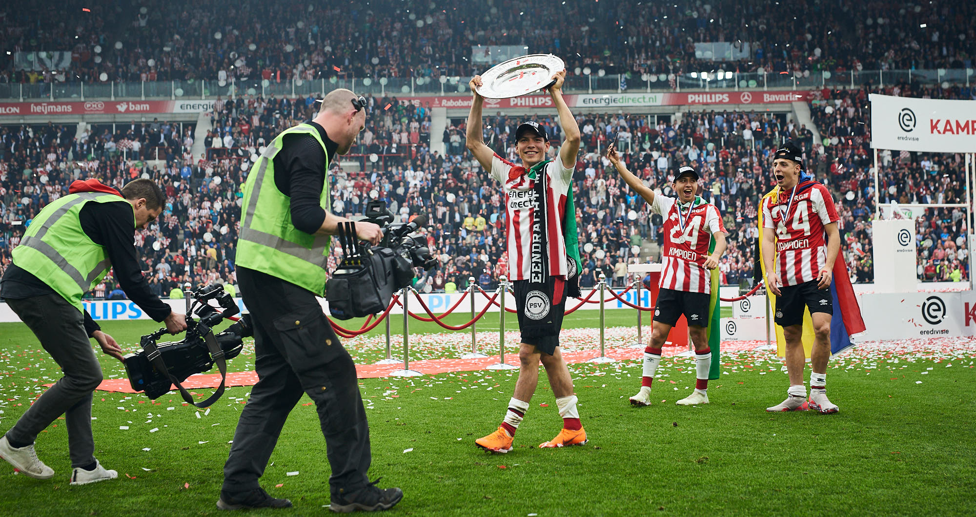 Mexican winger Hirving Lozano with the Dutch Eredivisie trophy in the Philips Stadium in Eindhoven
