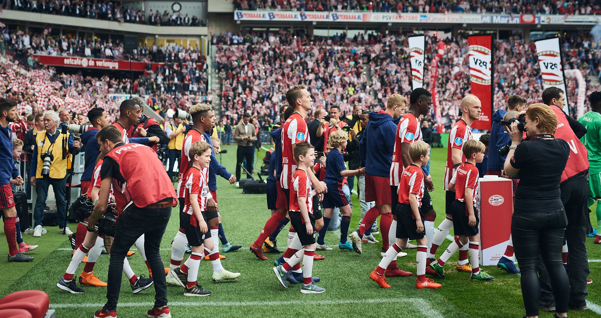 Football players entering the pitch of the Philips Stadium in Eindhoven