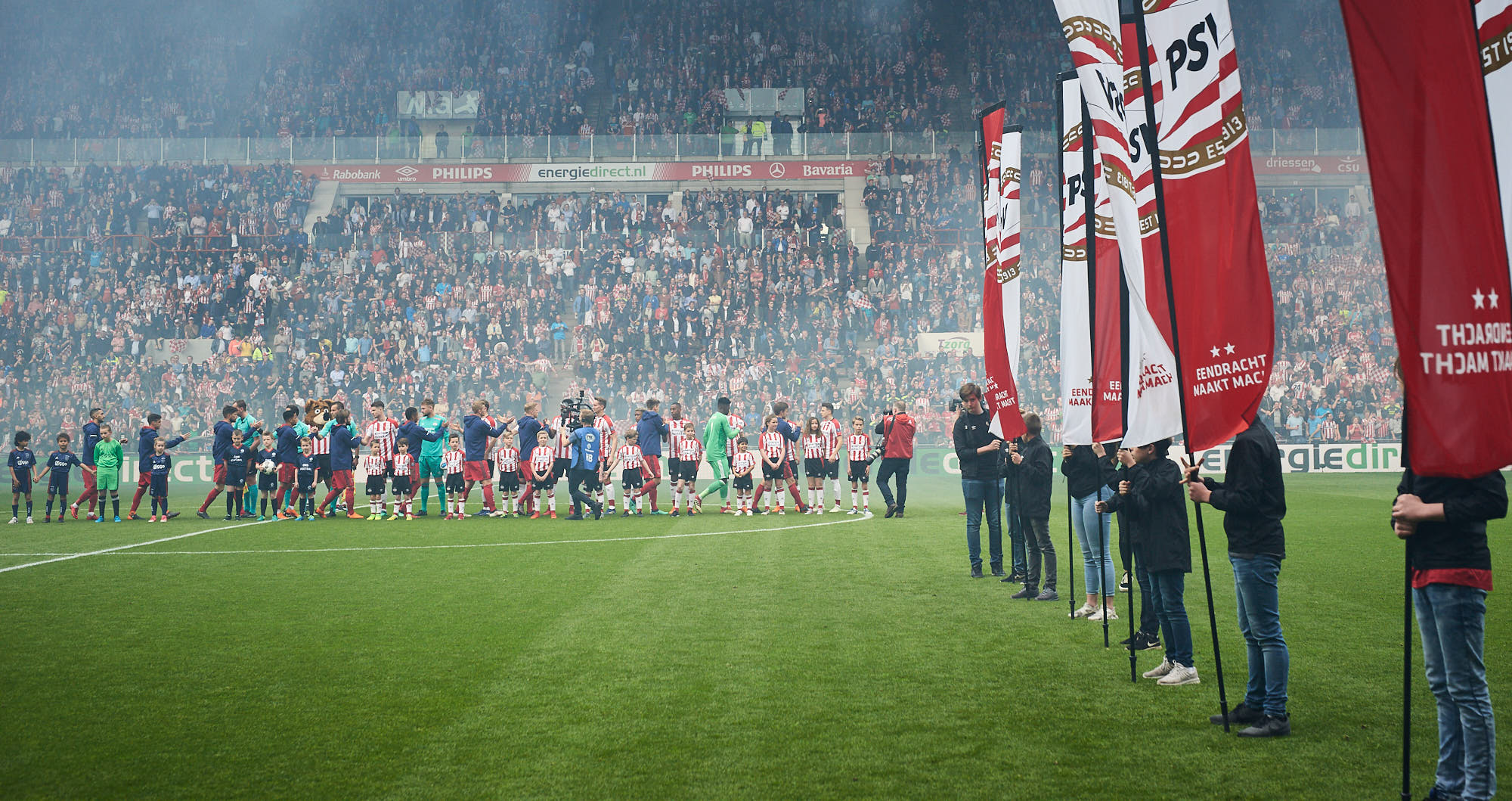 PSV Eindhoven and Ajax Amsterdam football players line up in the Philips Stadium