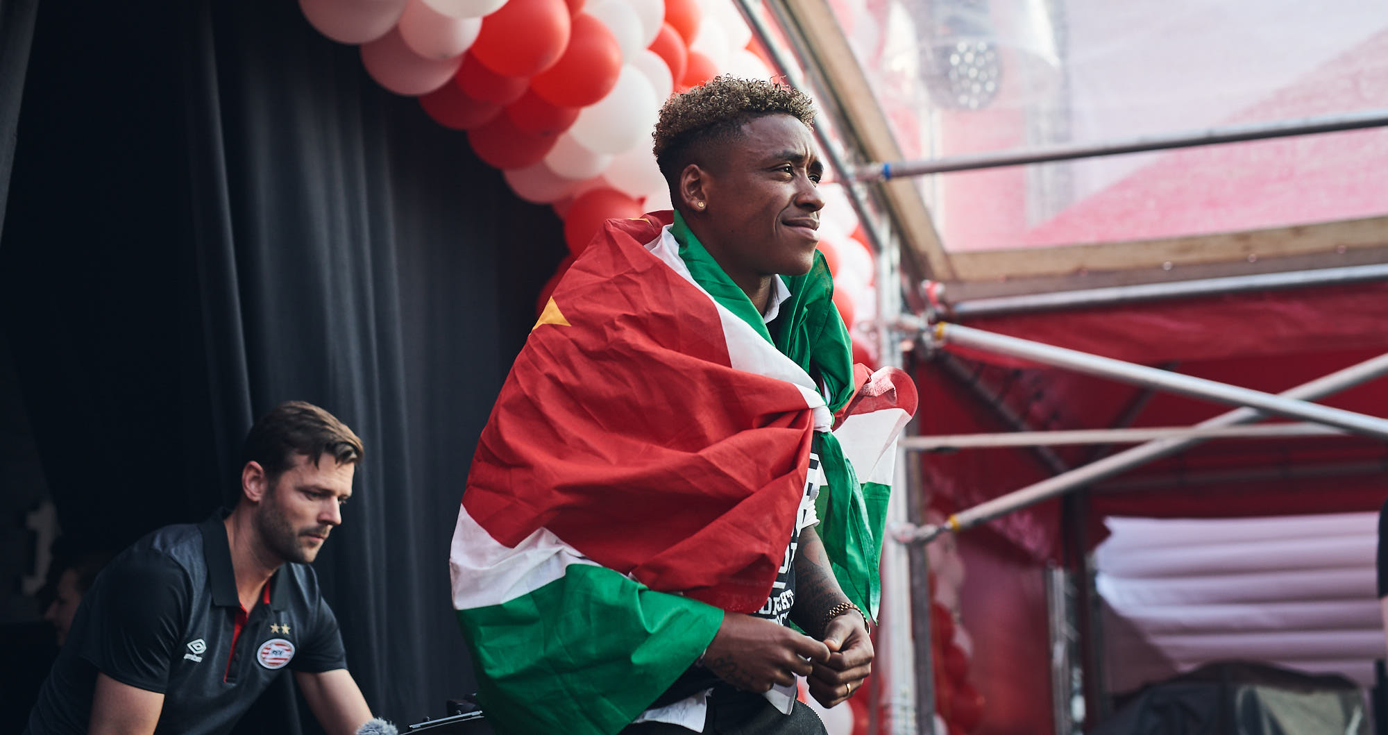 PSV winger Steven Bergwijn wrapped in a Suriname flag