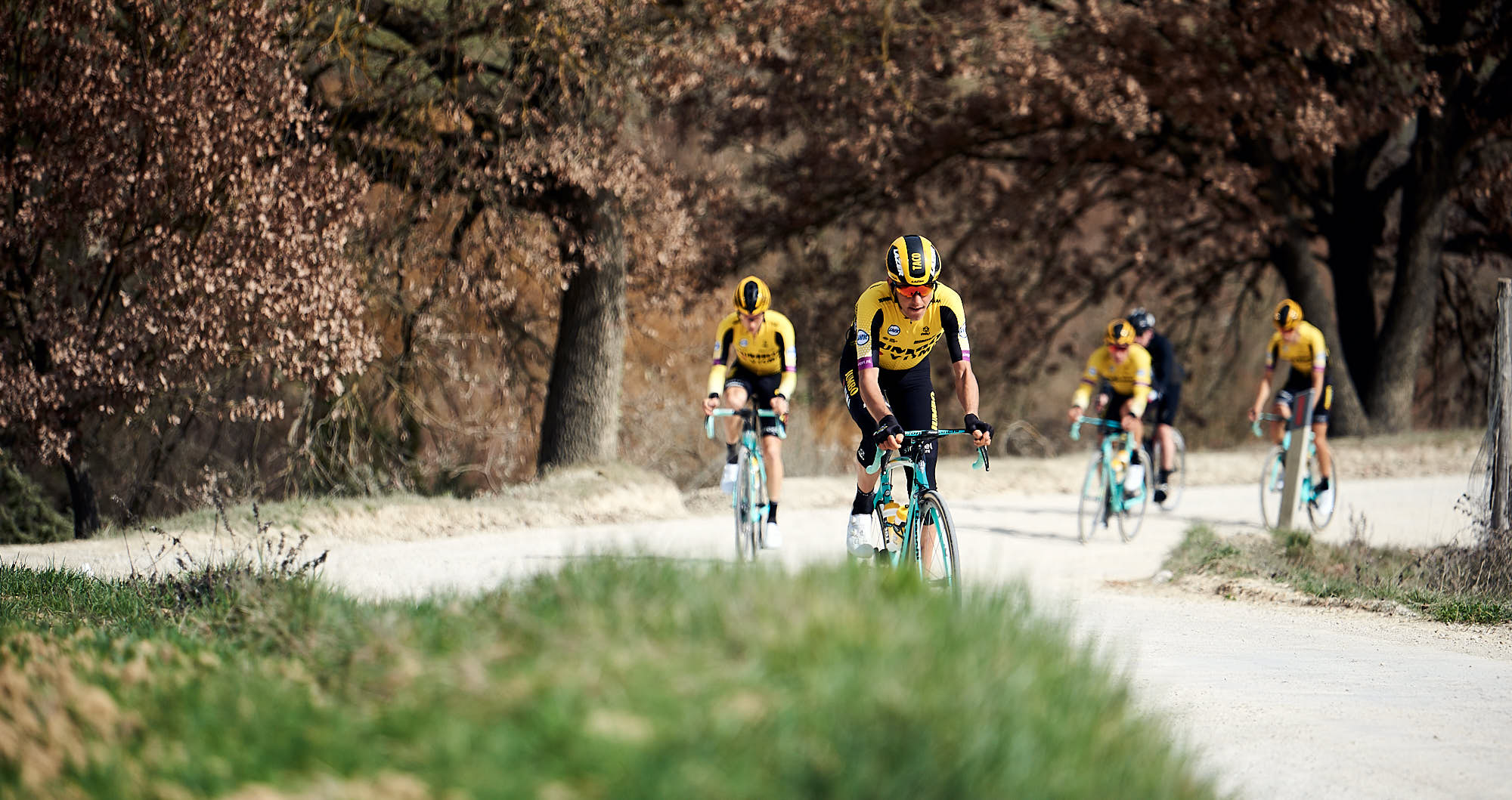 Jumbo-Visma cyclists riding the Strade Bianche, or white roads