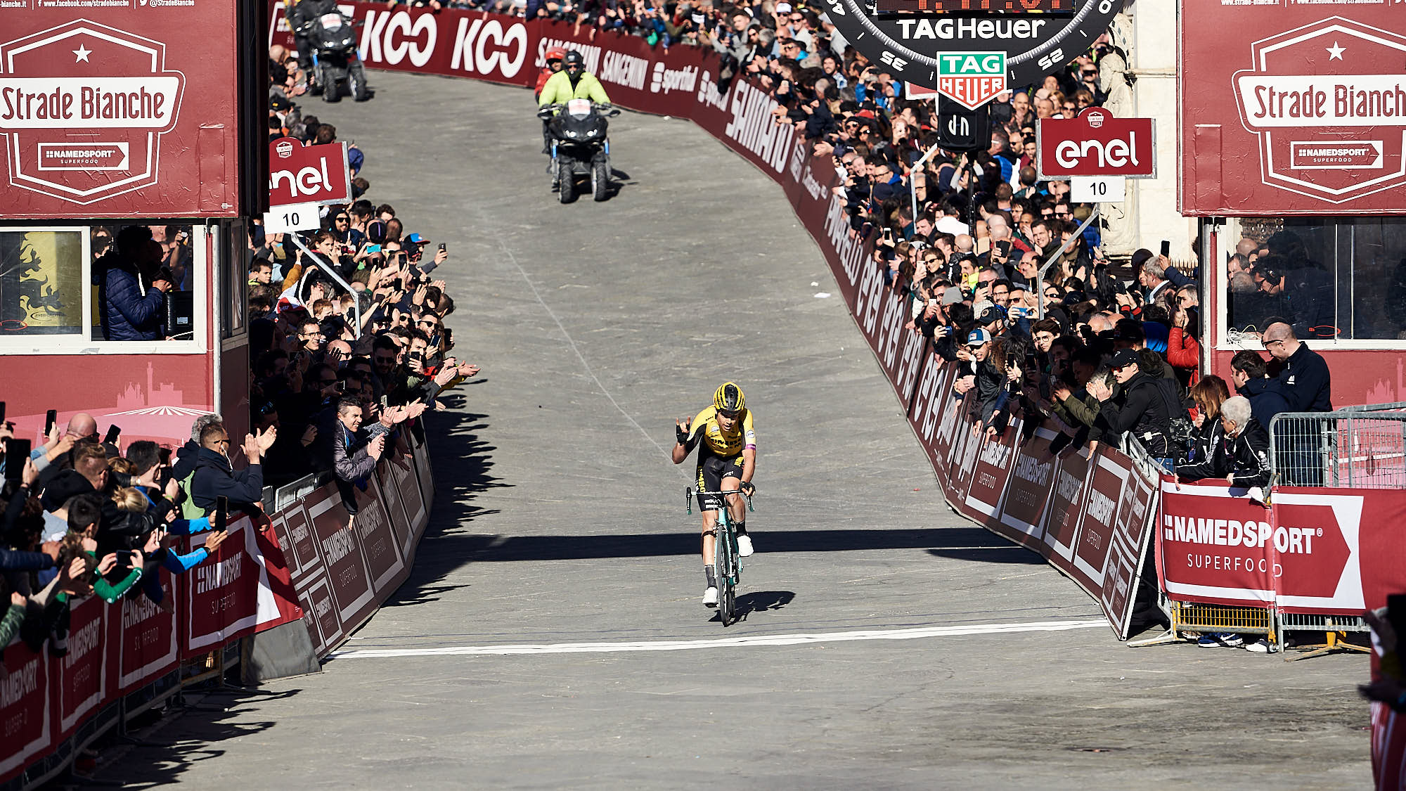 Wout van Aert crosses Strade Bianche finish line in third place