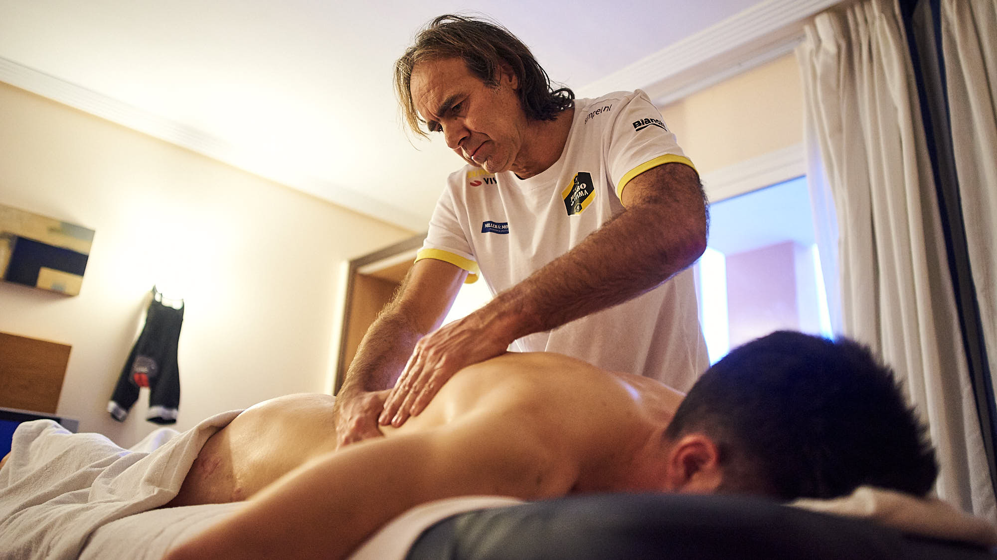 Soigneur at work, massaging a cyclist