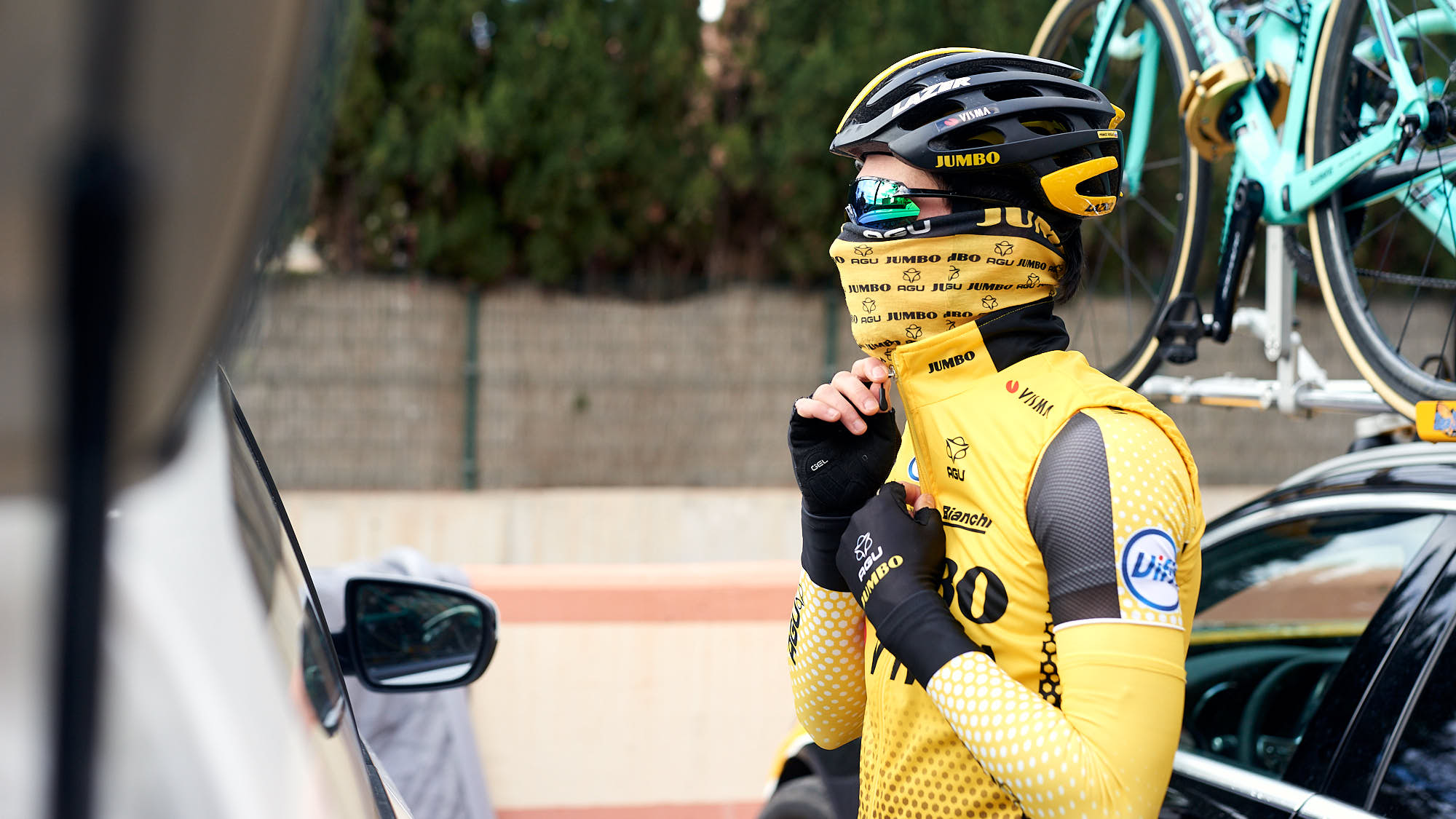 Jumbo-Visma cyclist Primoz Roglic getting dressed