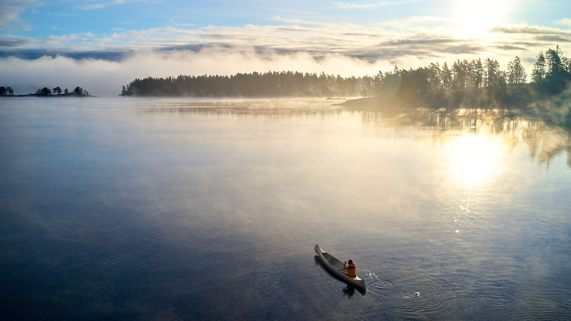 Canoe on a lake in Sweden at sunrise