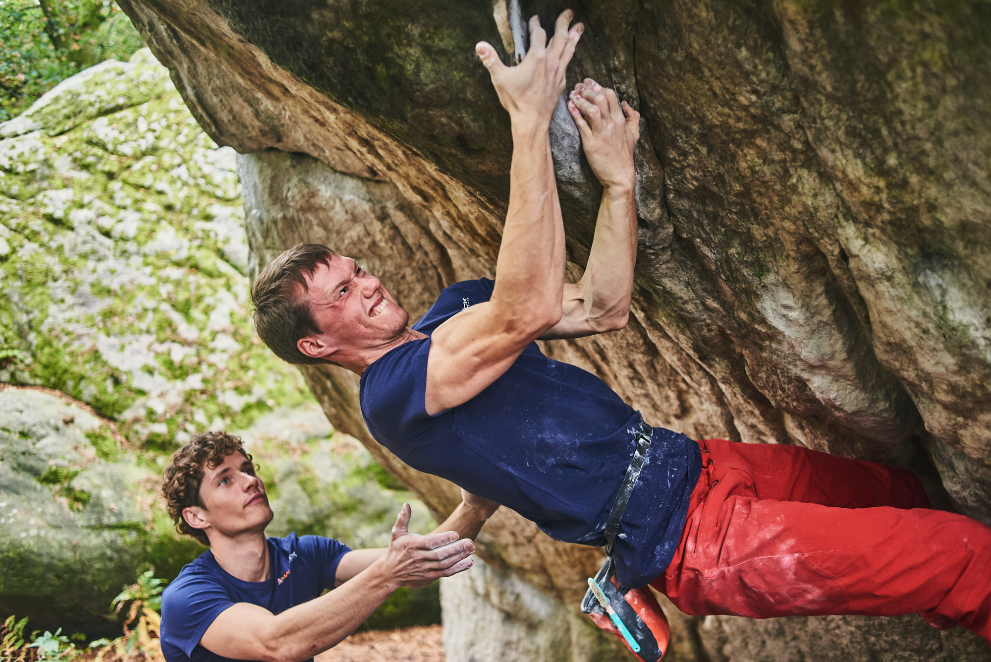 Mad Rock athlete Alexey Rubtsov climbing a boulder in Fontainebleau