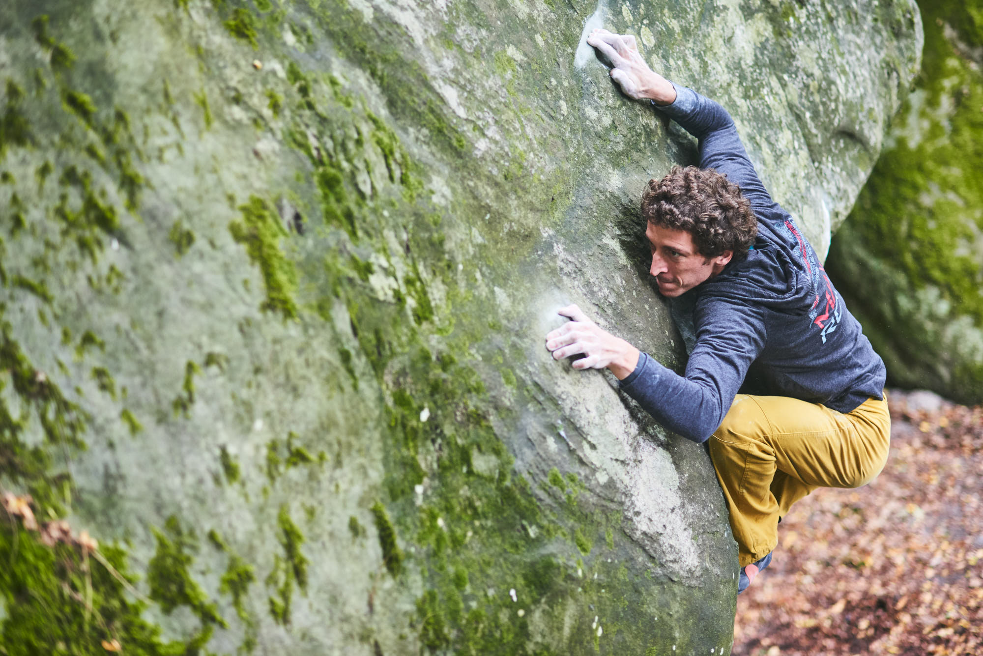 Guillaume Glairon Mondet climbing a hard boulder problem in Fontainebleau