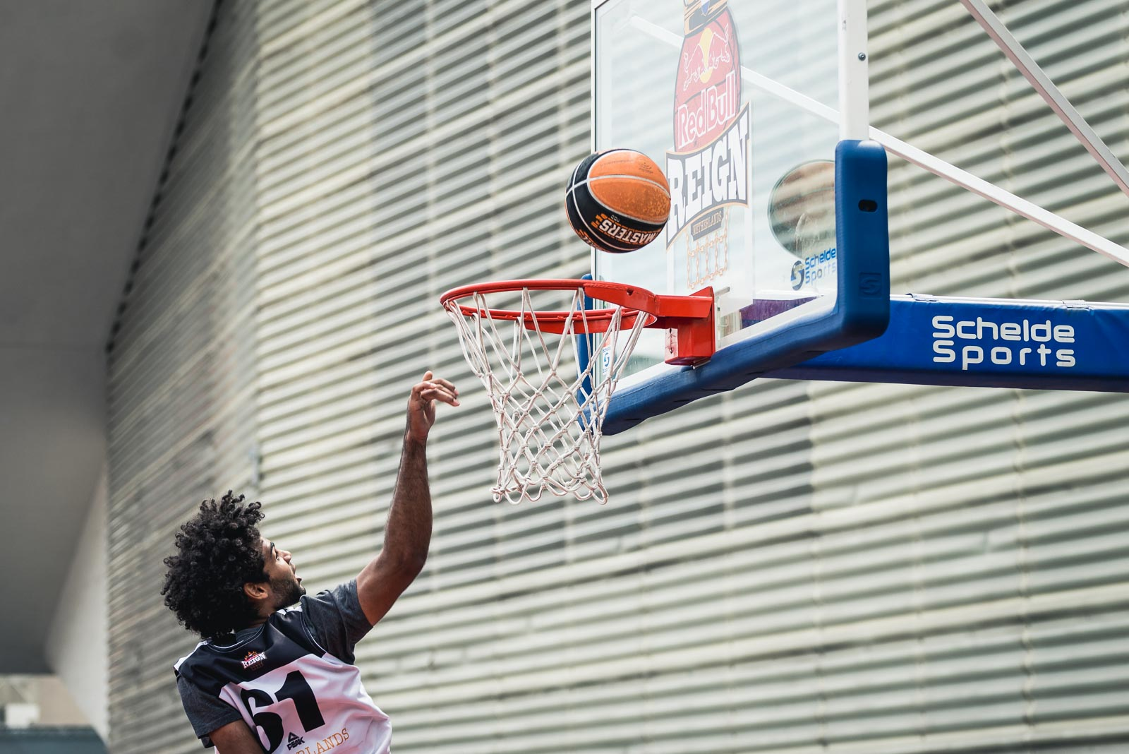 Basketball player scoring a point during Red Bull Reign in Rotterdam