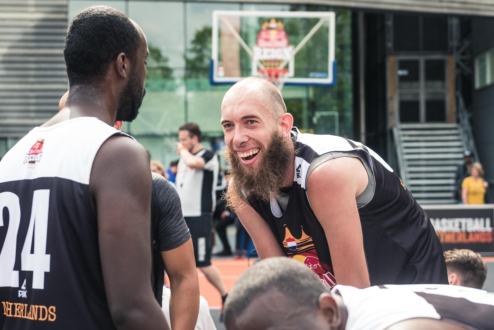 Basketball player laughing during Red Bull Reign in Rotterdam