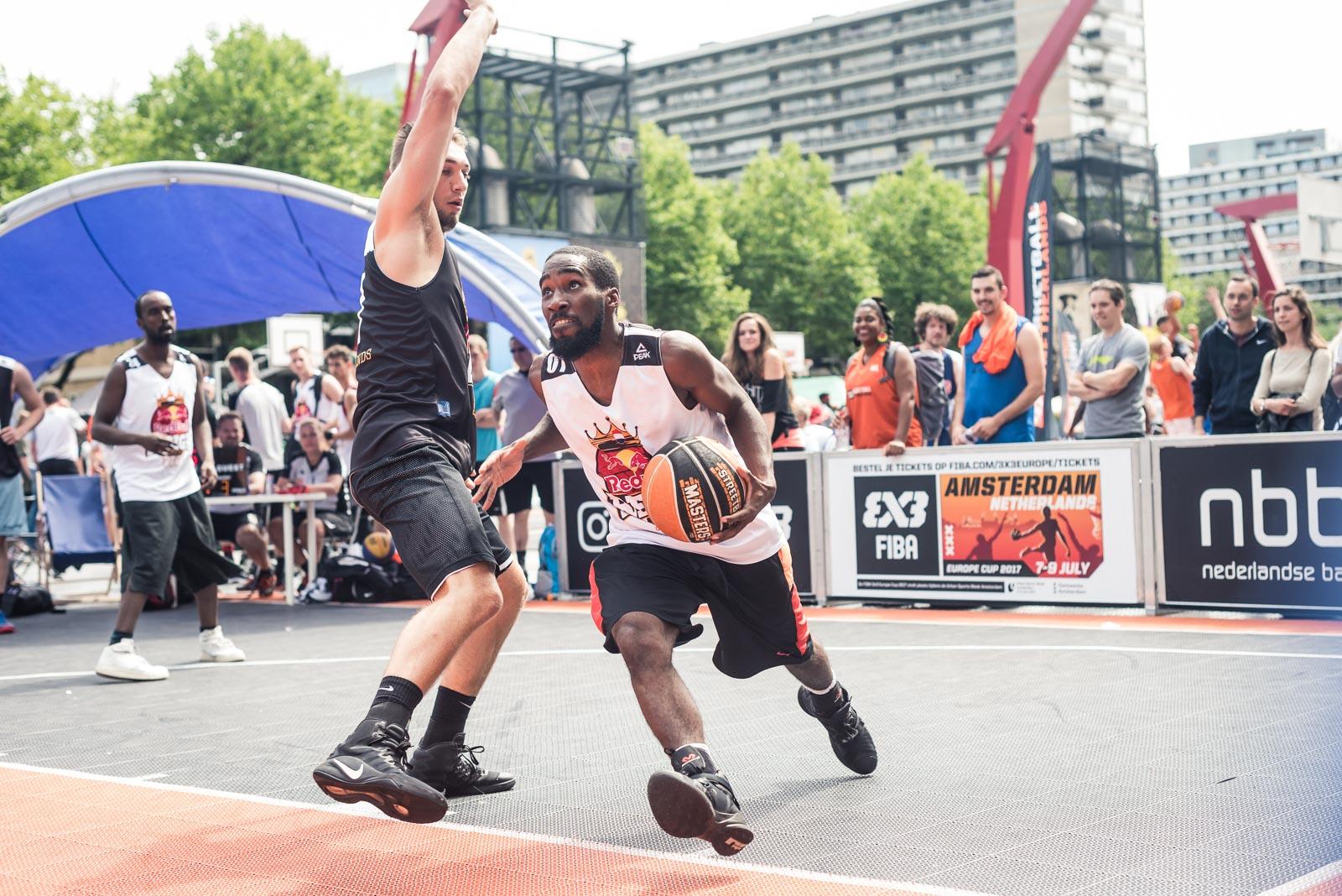 Basketball player driving the ball to the basket