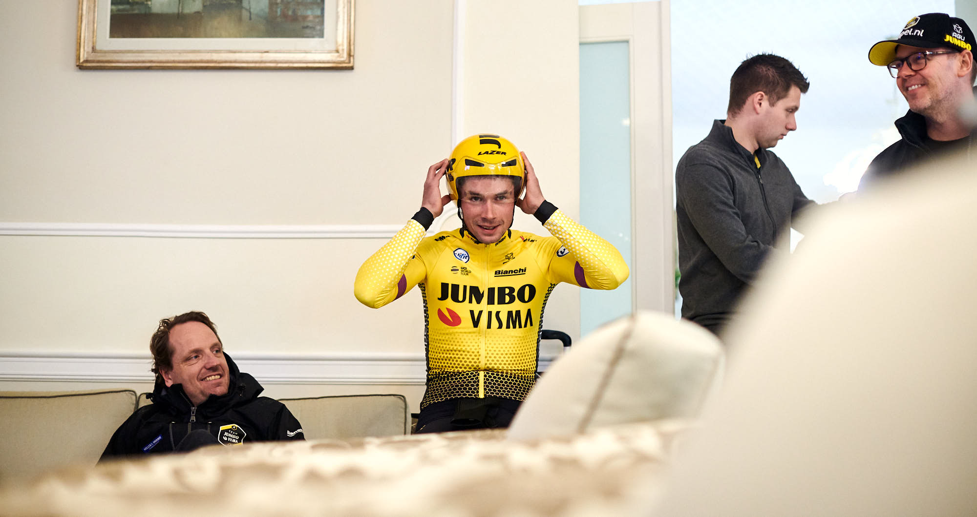 Slovenian cyclist Primoz Roglic putting on a time trial helmet