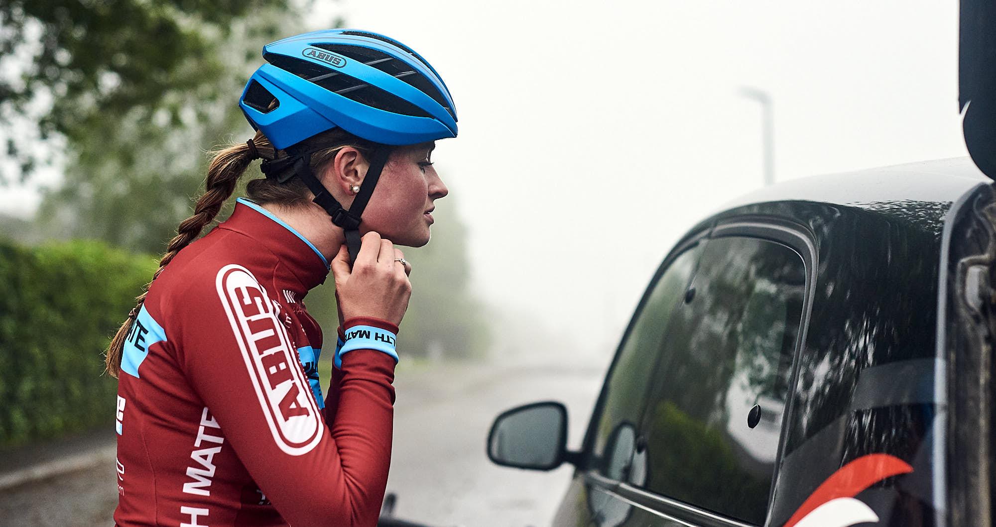 Cyclist Elodie Kuijper fixing her helmet