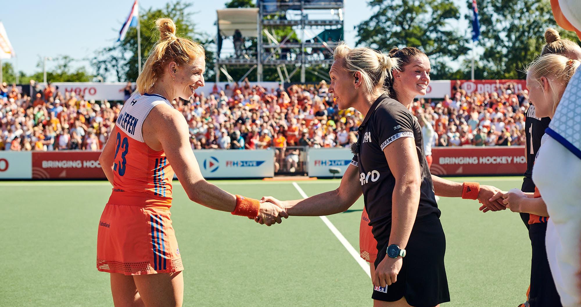 Margot van Geffen shaking a referee's hand during FIH Pro league finals in Amsterdam