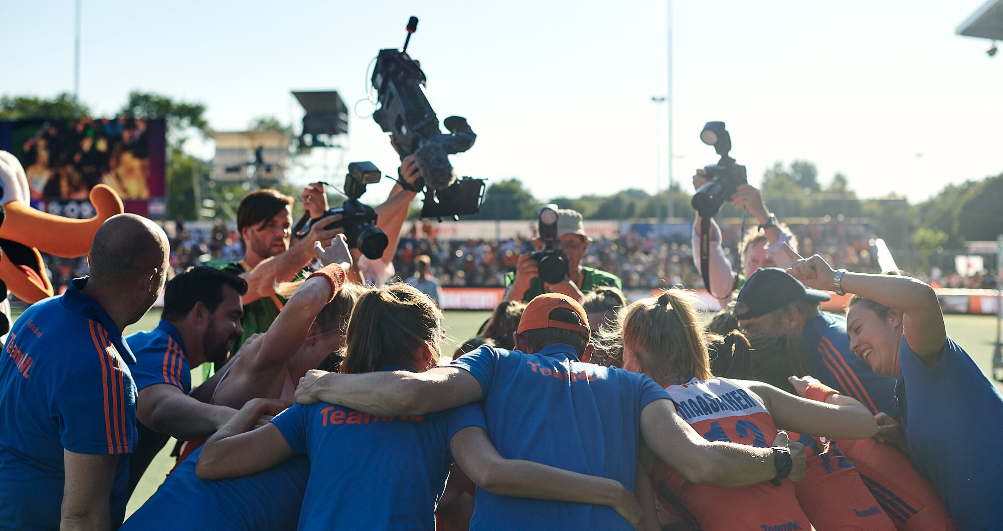 Dutch hockey team players and staff embrace after winning the FIH pro league final in Amsterdam
