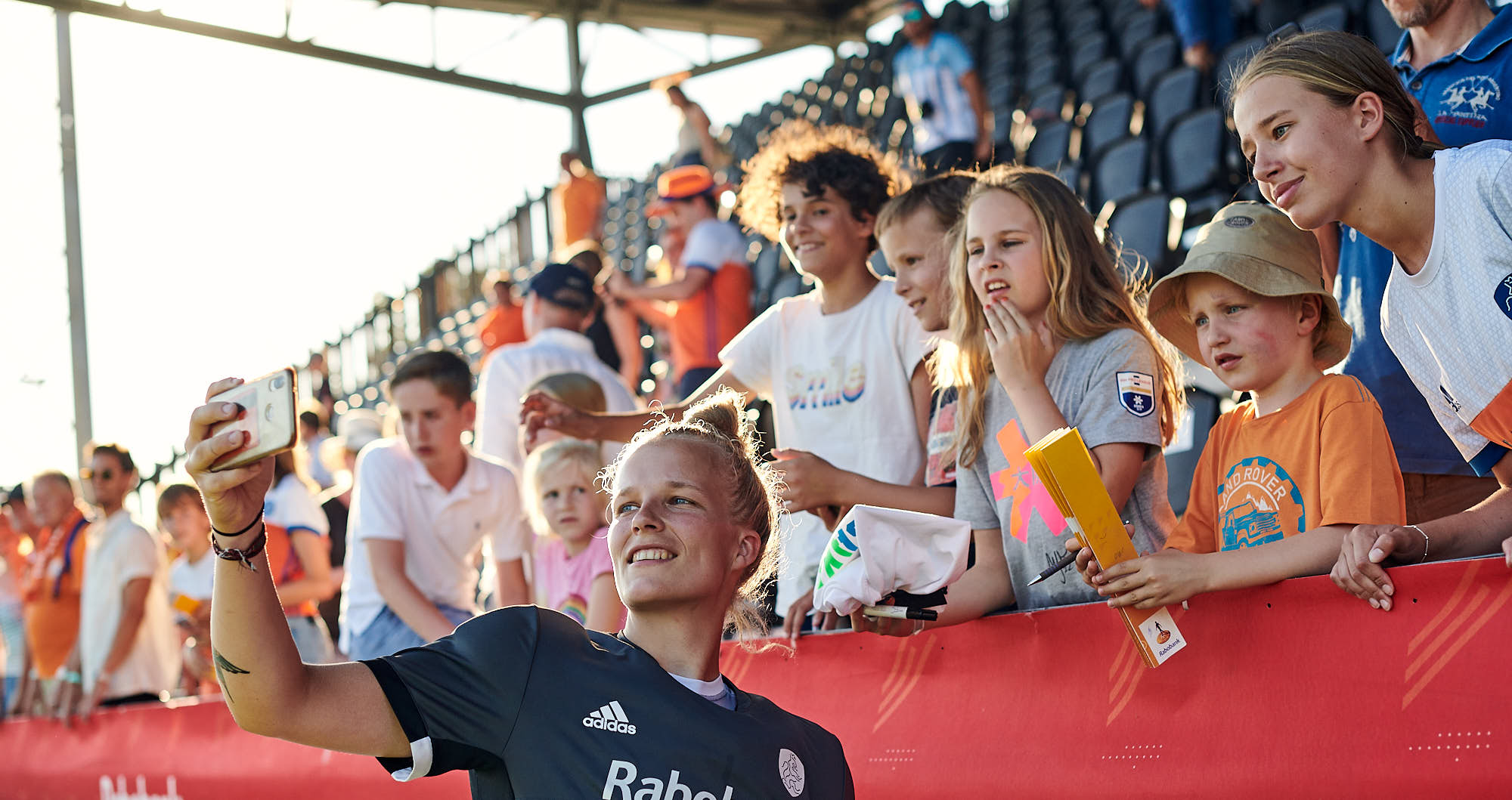 Dutch national hockey team player taking a selfie with fans at FIH pro league finals 2019 in Amsterdam
