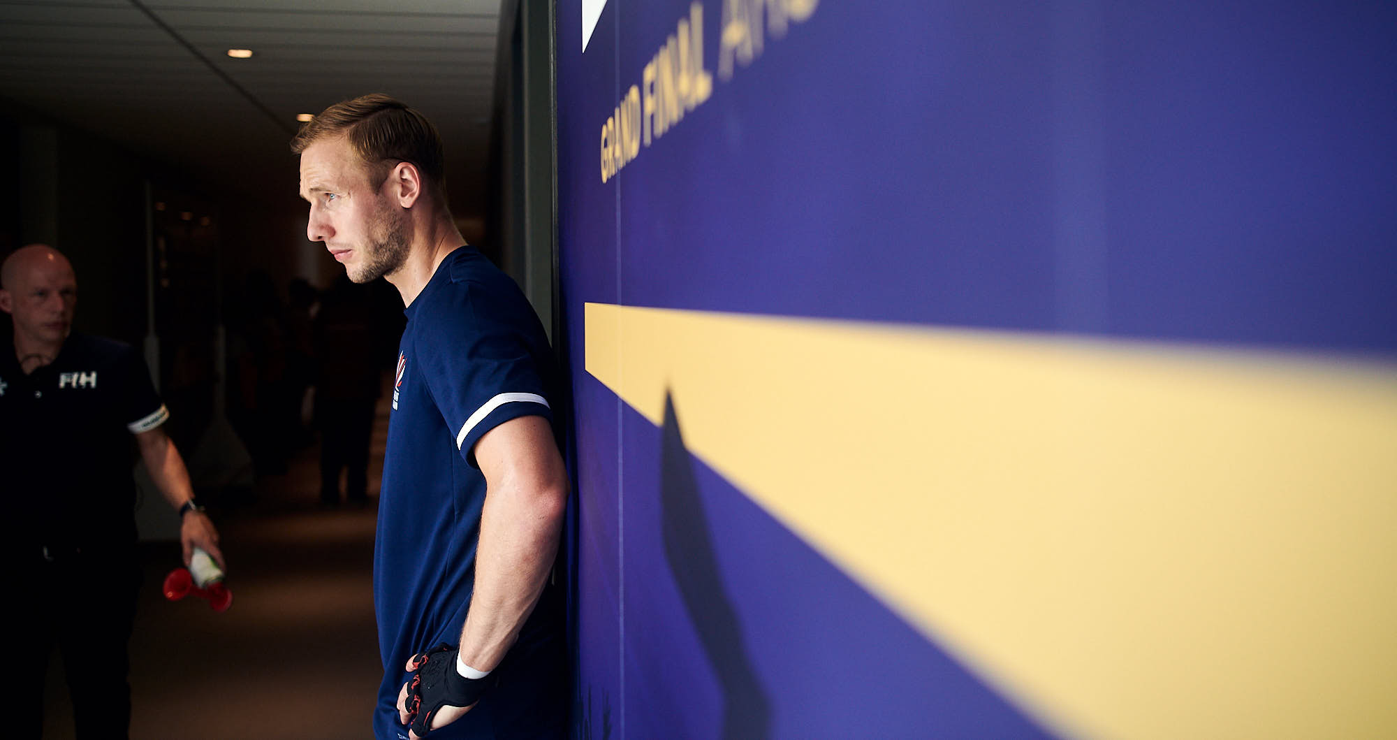 English hockey player taking a moment of focus behind the scenes at FIH Pro League