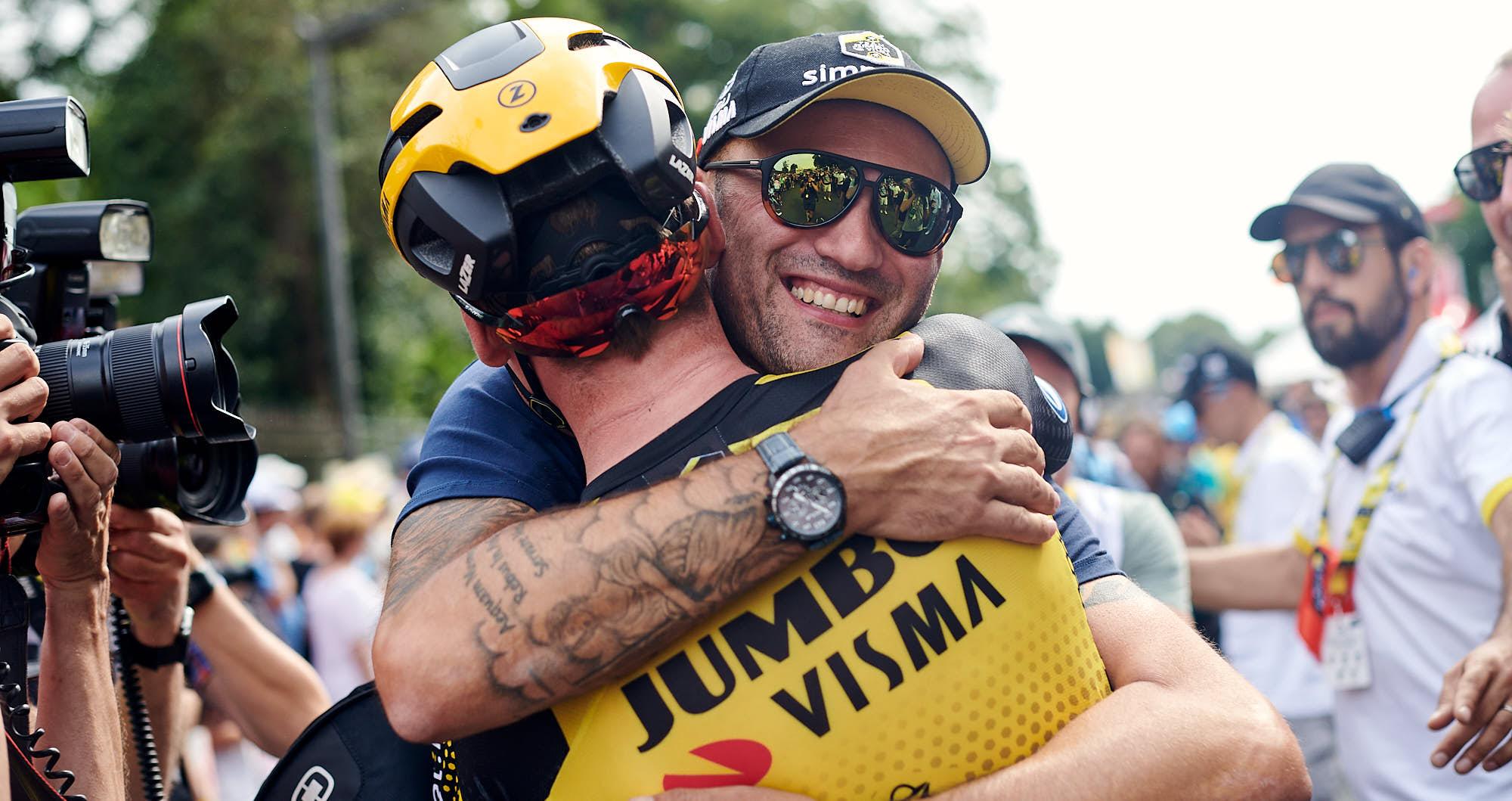 Mike Teunissen embracing a Jumbo-Visma soigneur