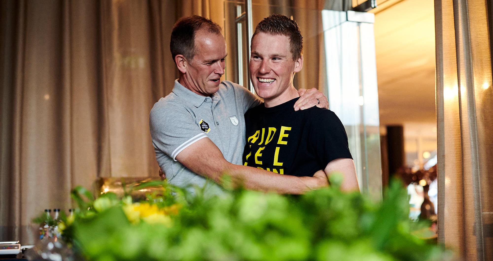 Jumbo-Visma team manager Richard Plugge embracing Mike Teunissen