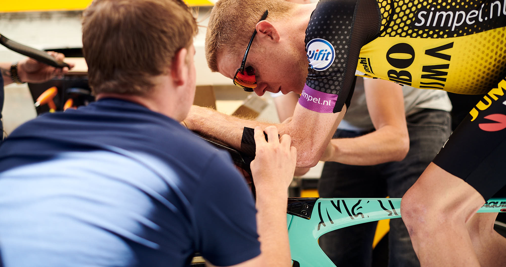 Steven Kruijswijk and a mechanic working on his time trial bike before the Tour de France in Brussels
