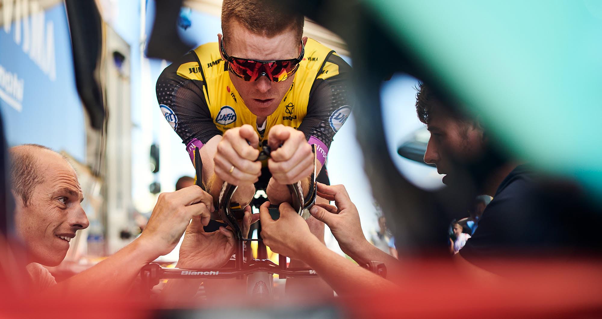 Steven Kruijswijk and Jumbo-Visma staff fine-tuning the cyclist's time trial bike