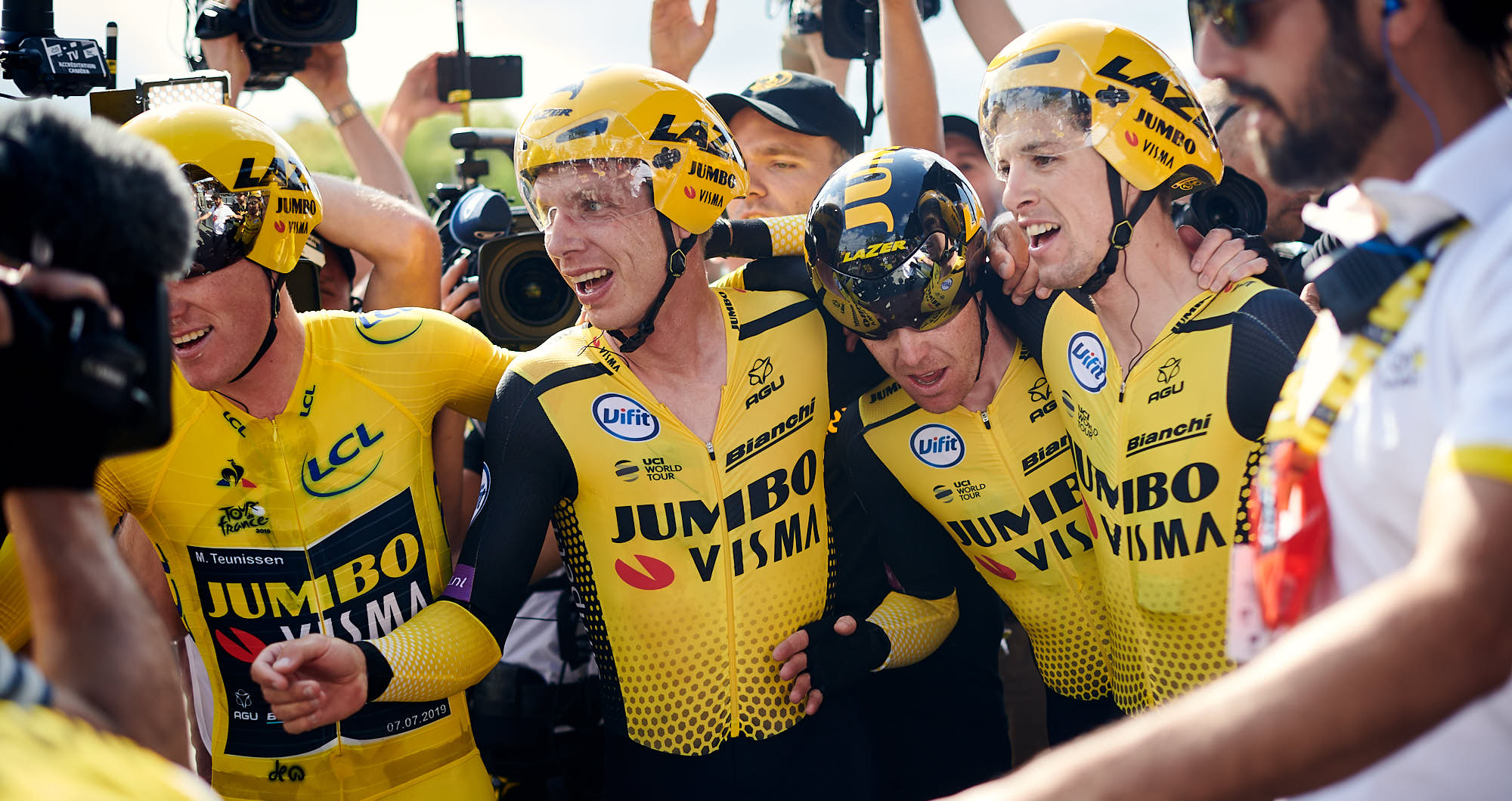 Team Jumbo-Visma riders embrace after winning the 2019 Tour de France team time trial