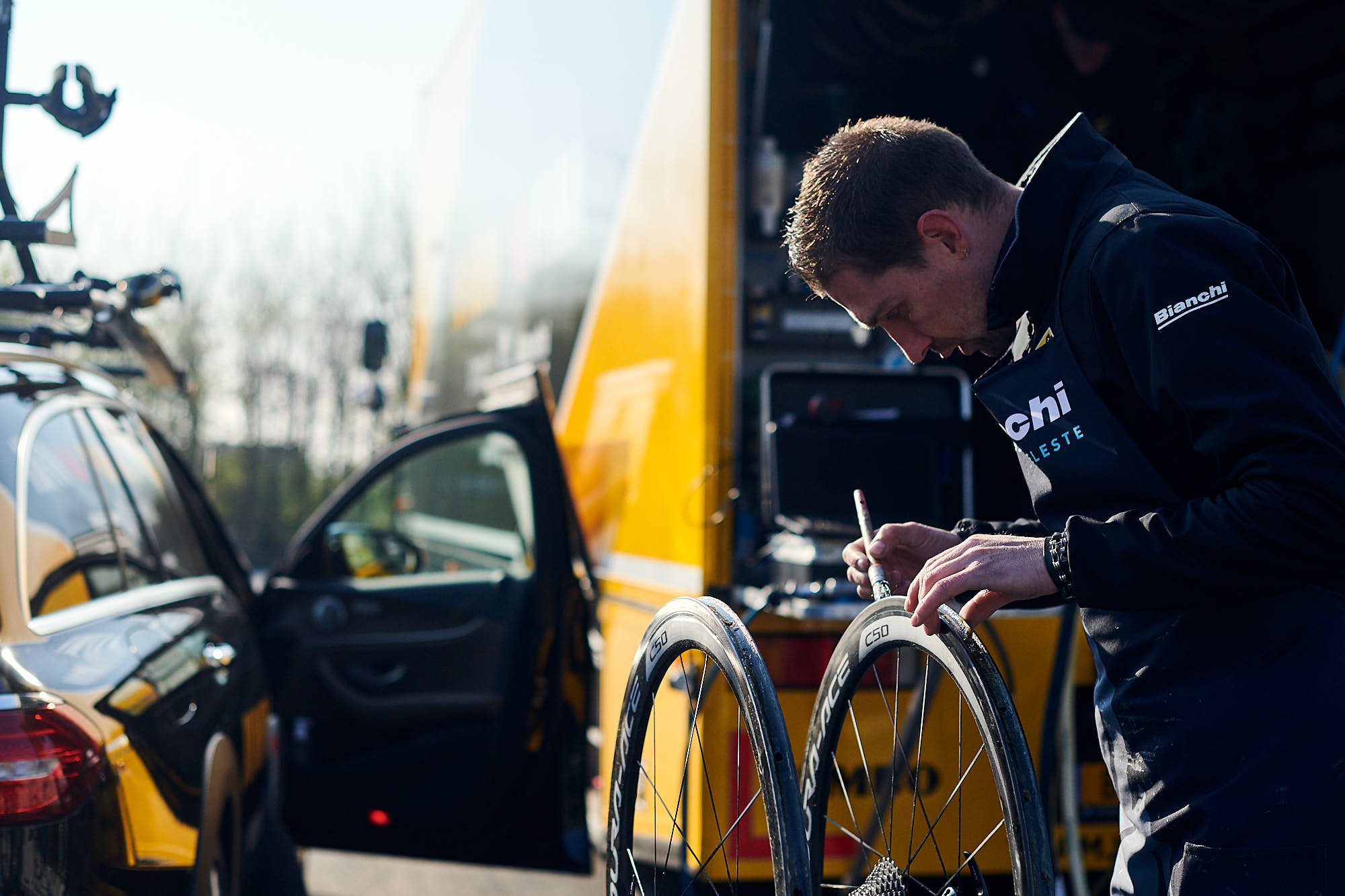 Wout van Aert putting on his cycling shoes