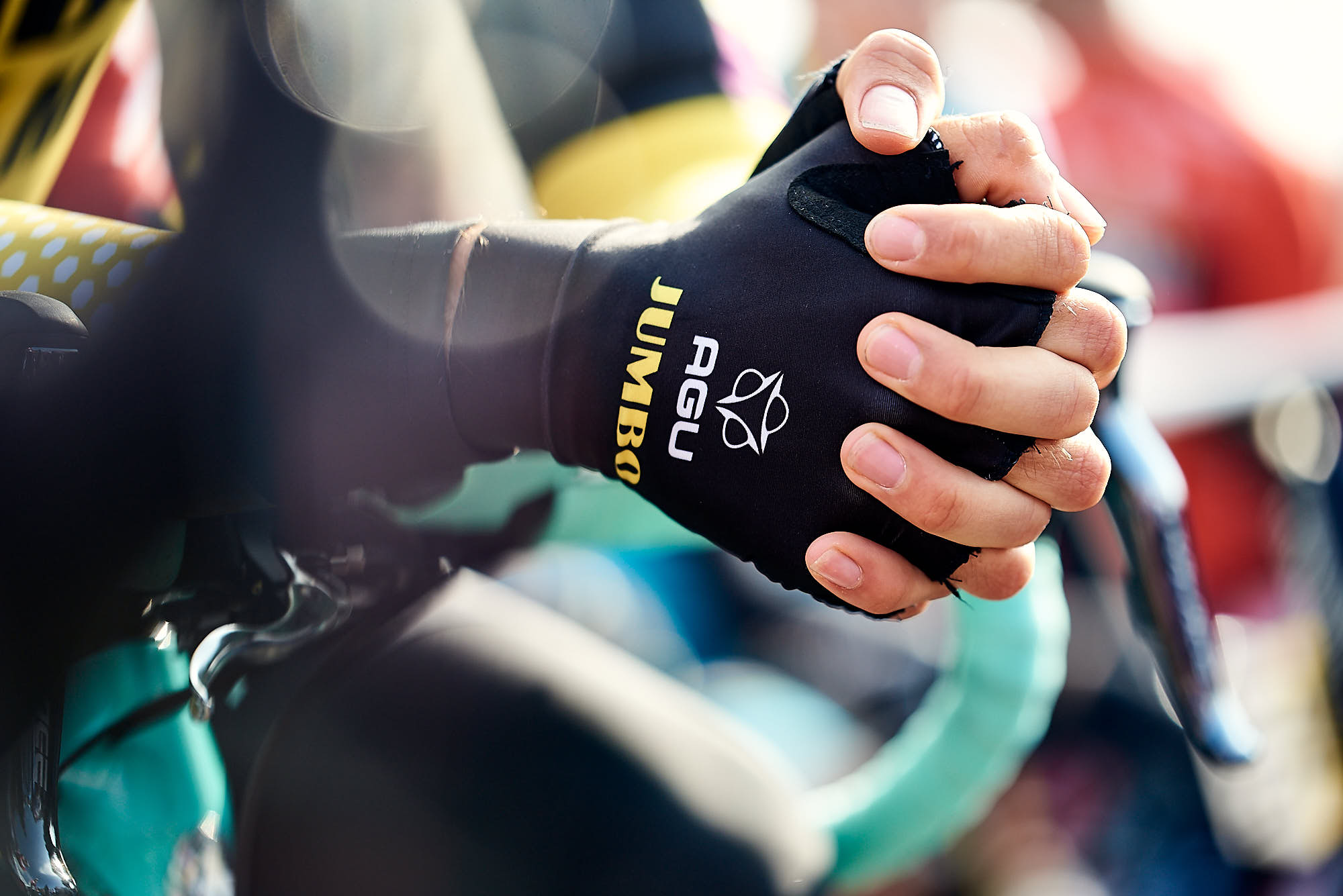 Hands of Wout van Aert, resting on his handlebars