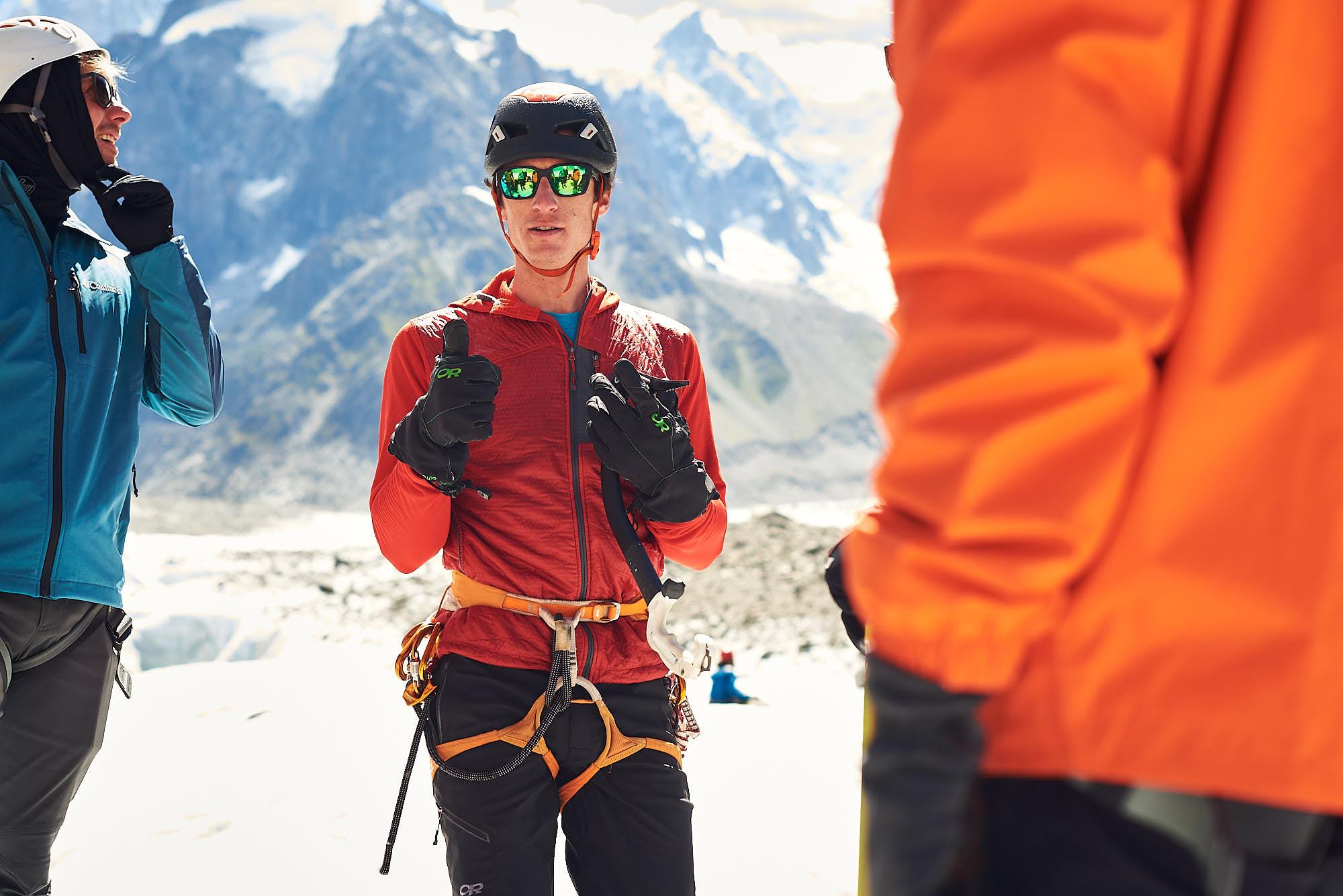 Mountain guide explaining some techniques on the Mer de Glace glacier