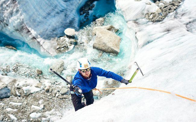 Mountaineer ice climbing on the Mer de Glace glacier