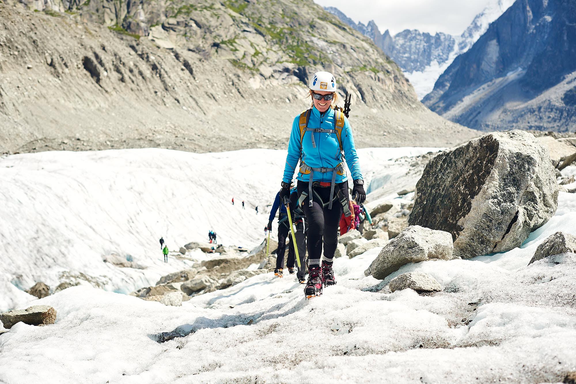 Alpinist walking on the Mer de Glace glacier near Chamonix