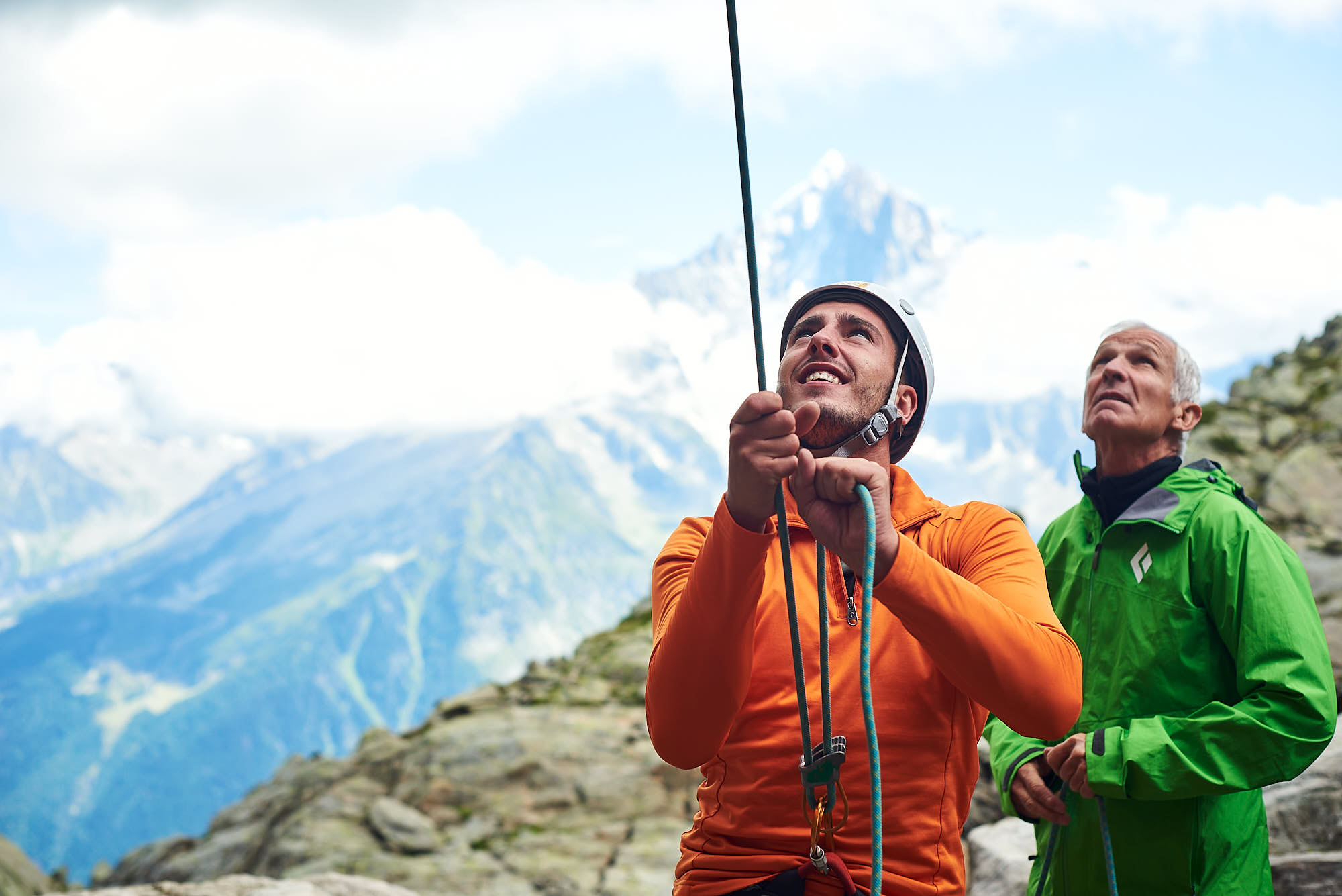 Climbers belaying a fellow mountaineer in the French Alps