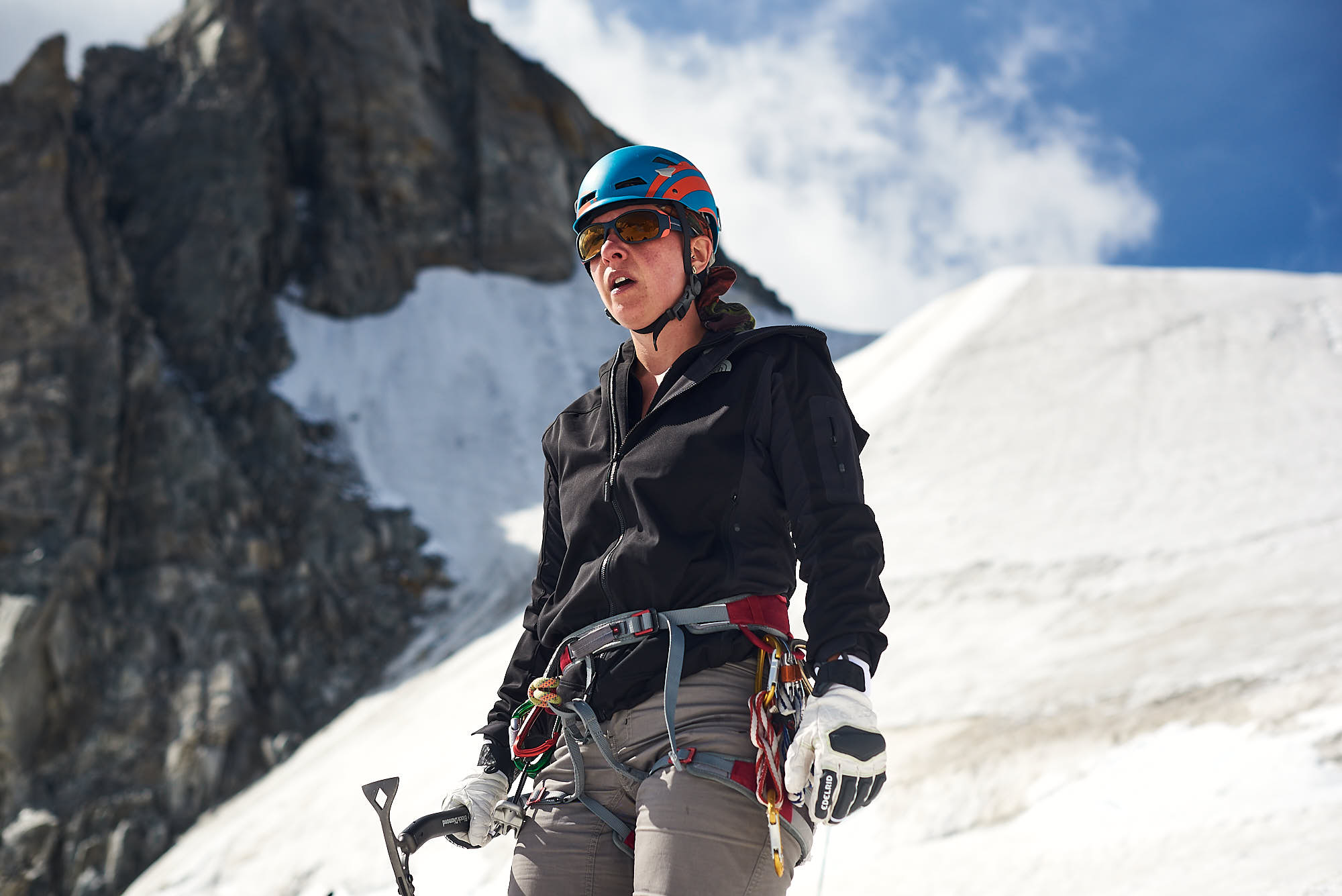 Female alpinist on Italian side of Mont Blanc, holding an ice axe