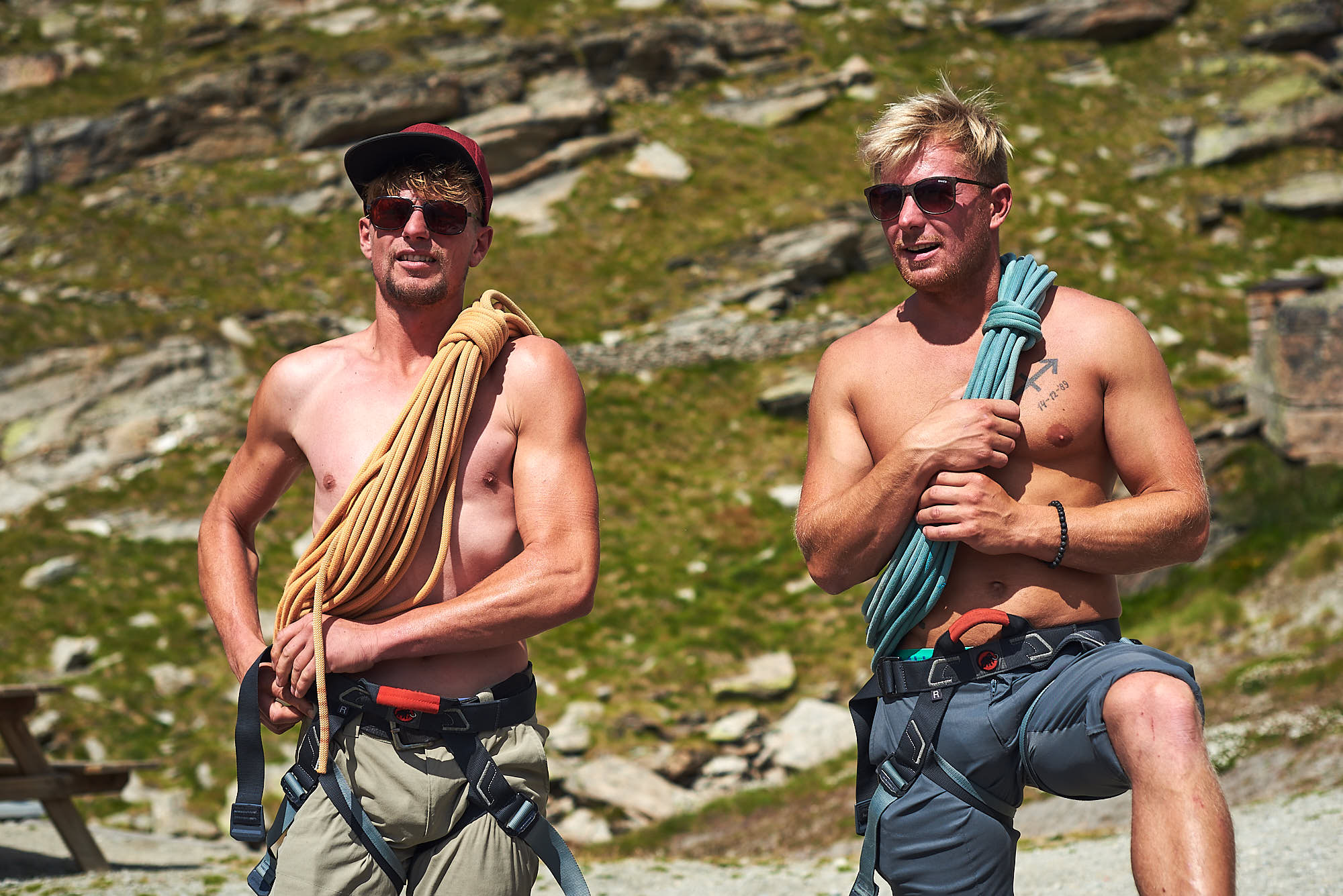 Two male alpinists preparing their gear