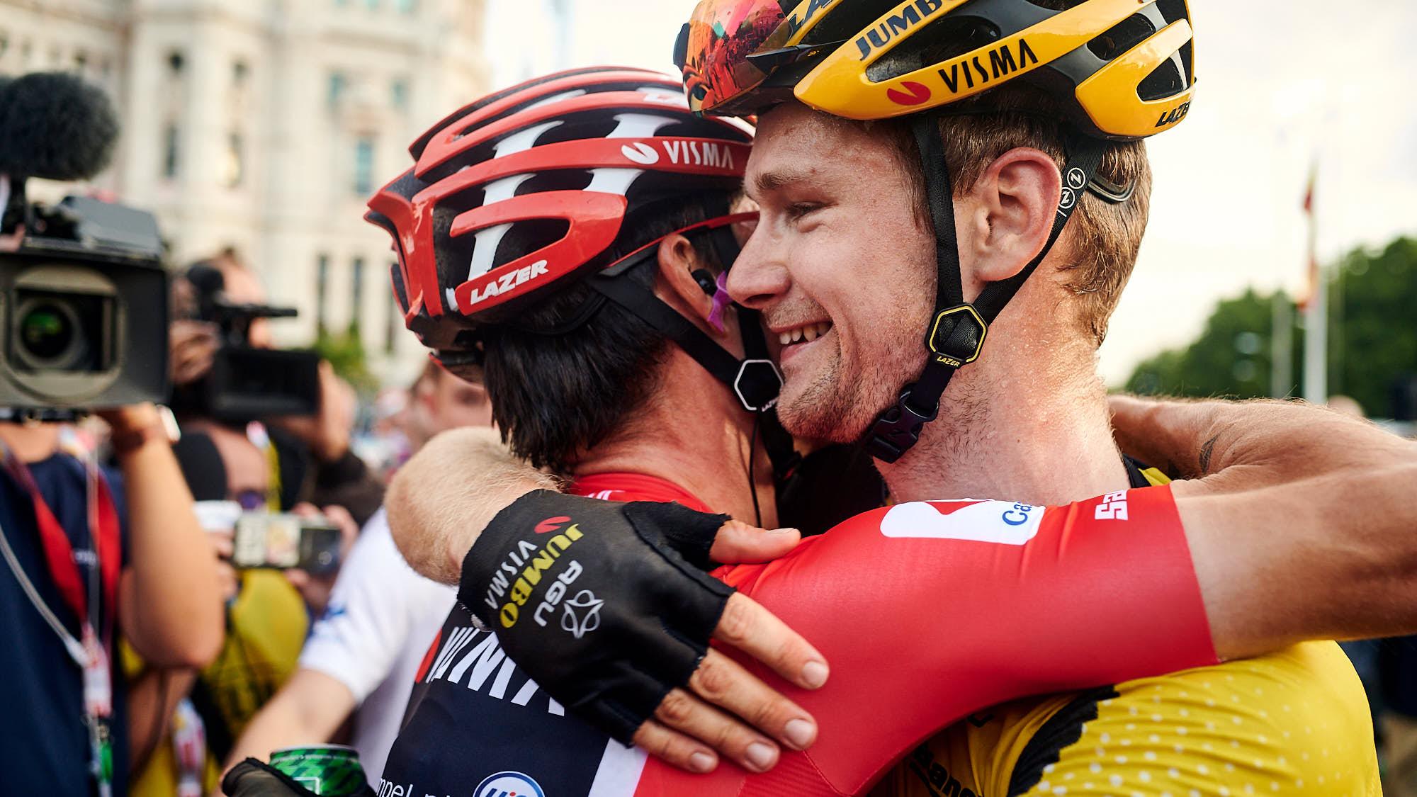 Dutch cyclist Lennard Hofstede embracing Primoz Roglic in Madrid