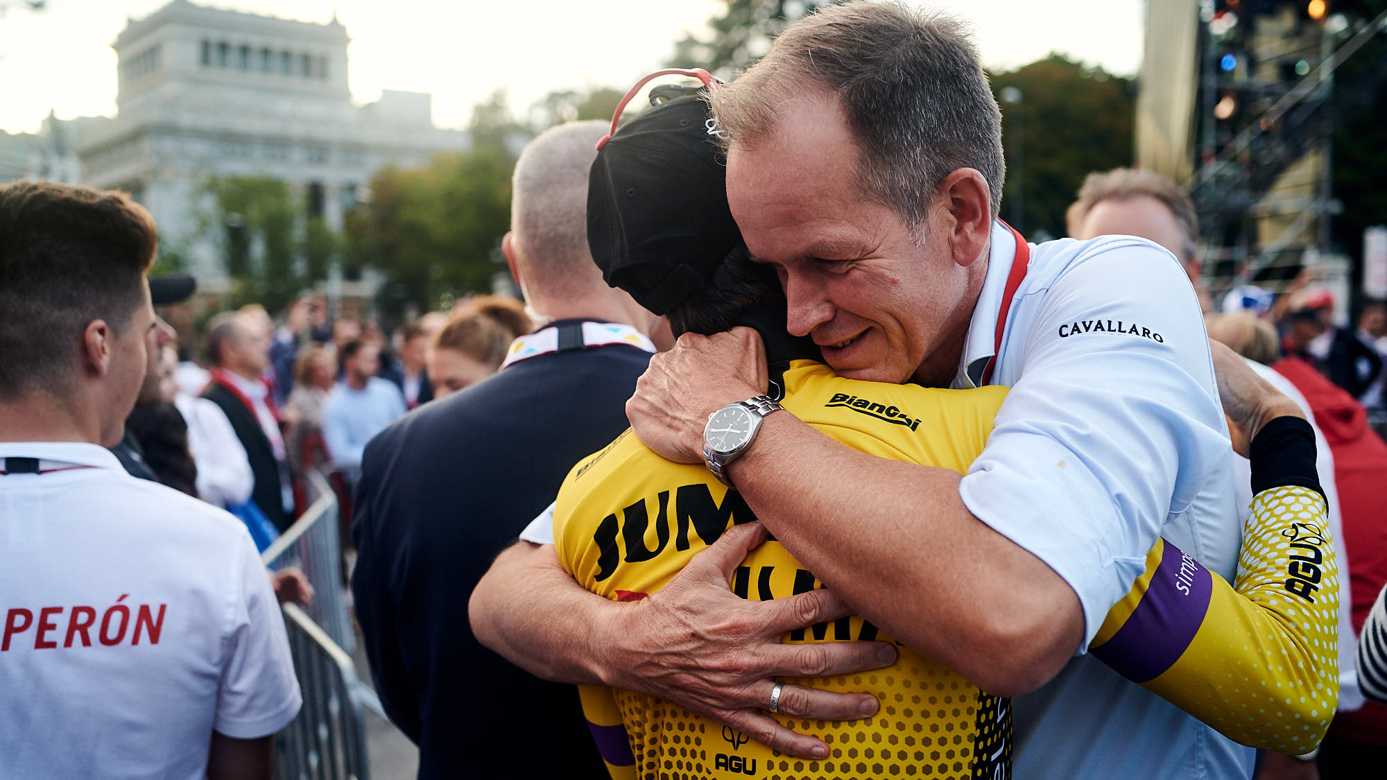 Richard Plugge embracing Primoz Roglic after he won La Vuelta in Madrid