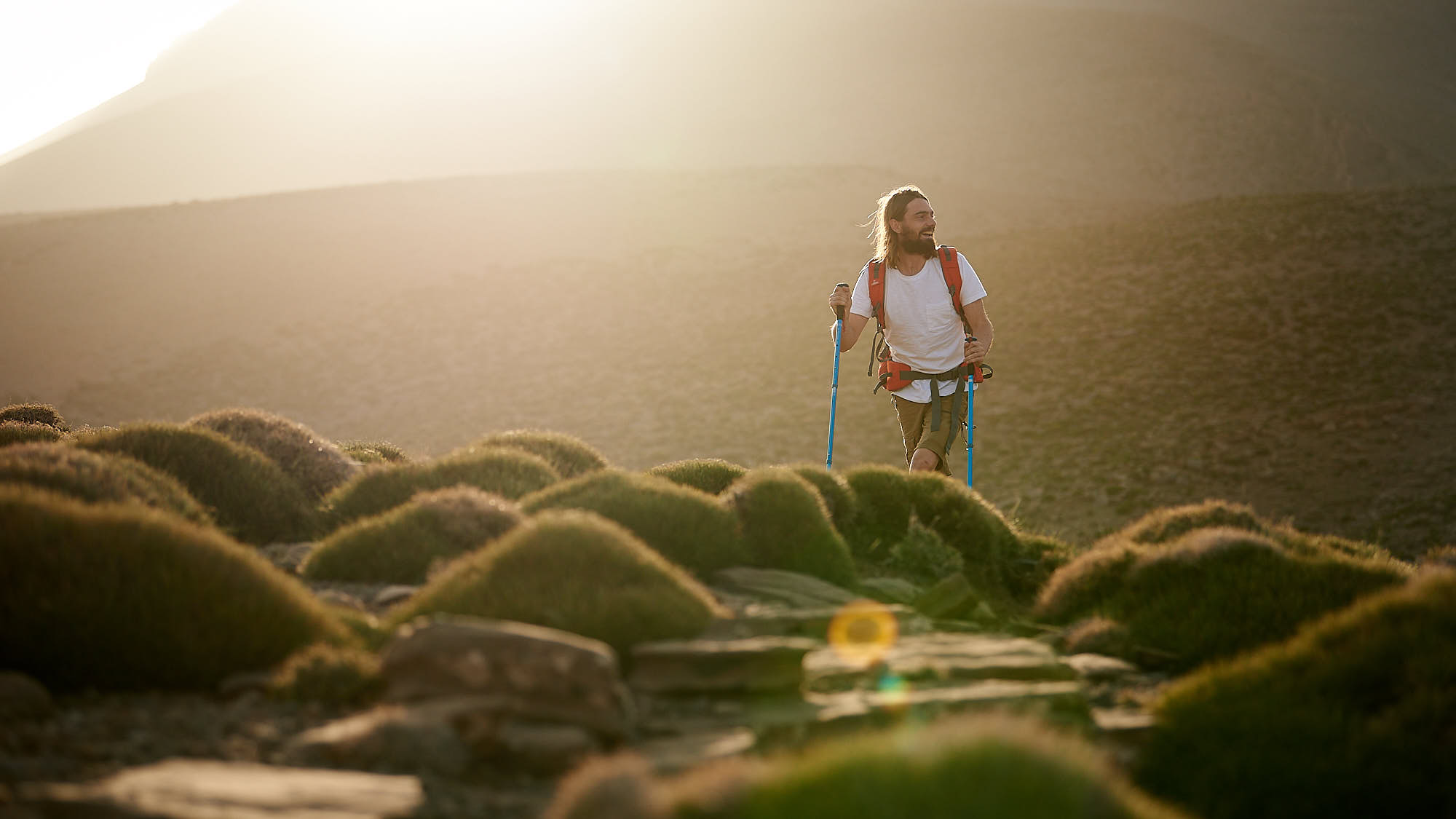 Hiker walking through Morocco's High Atlas at sunrise