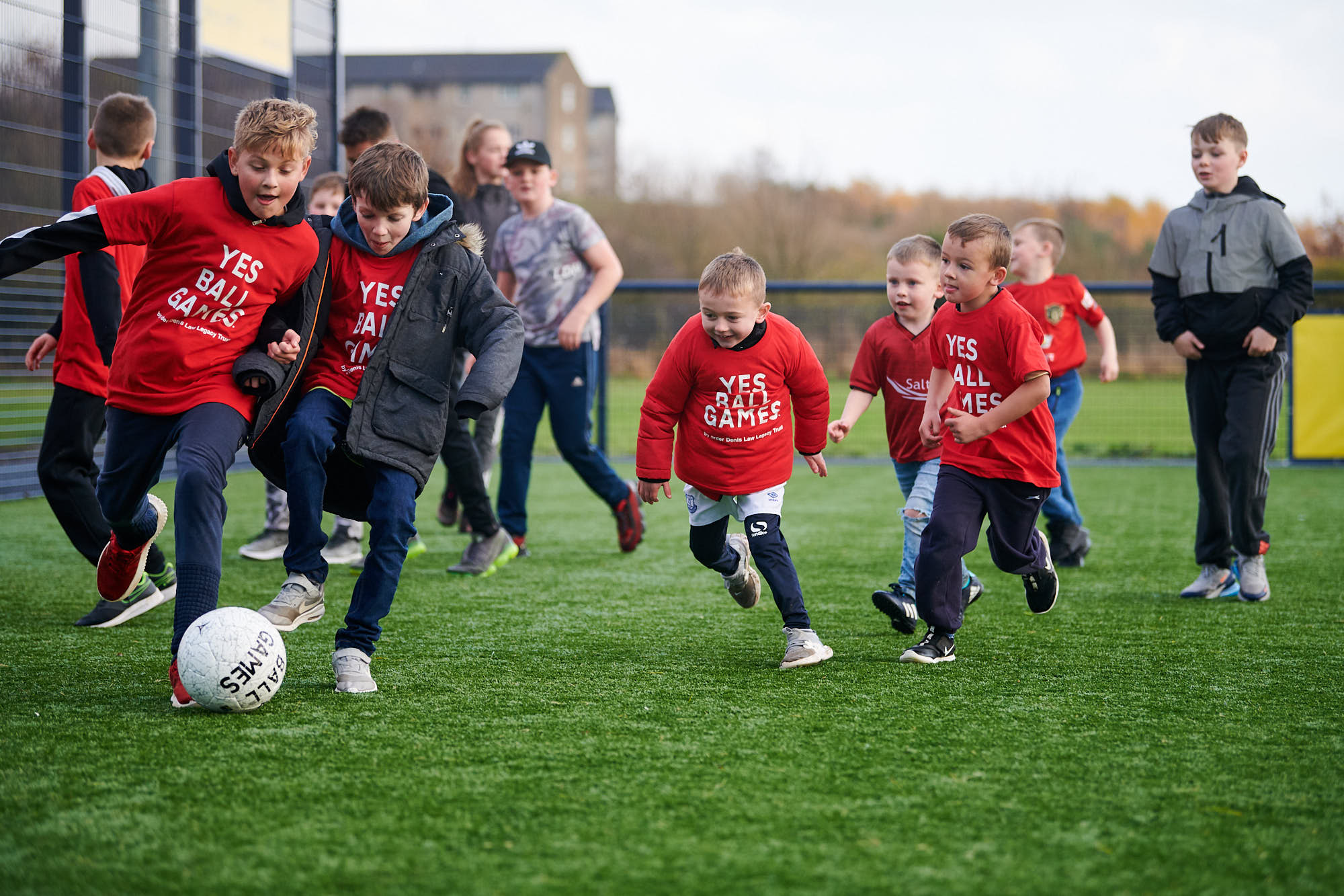 Children playing football on a Cruyff Court in Aberdeen