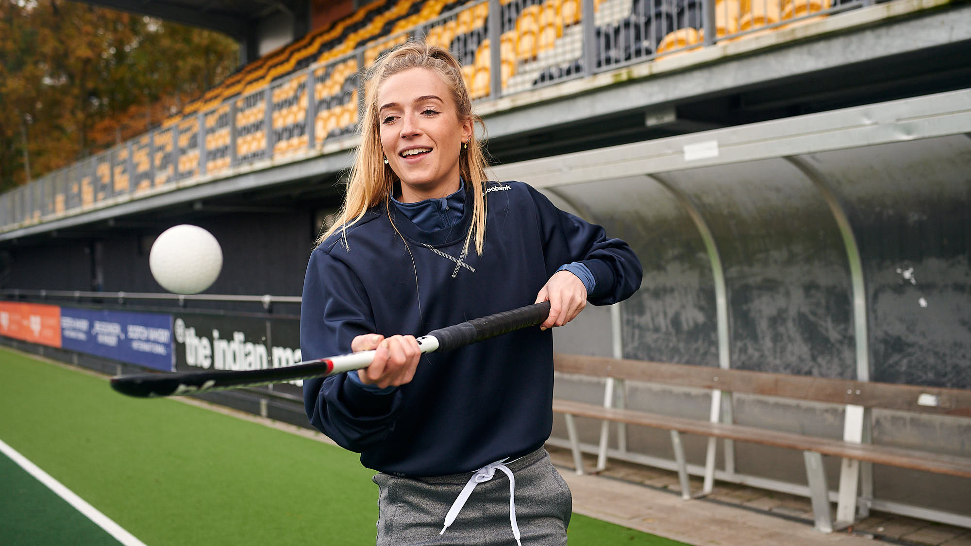 Dutch athlete Sanne Koolen handling a hockey ball