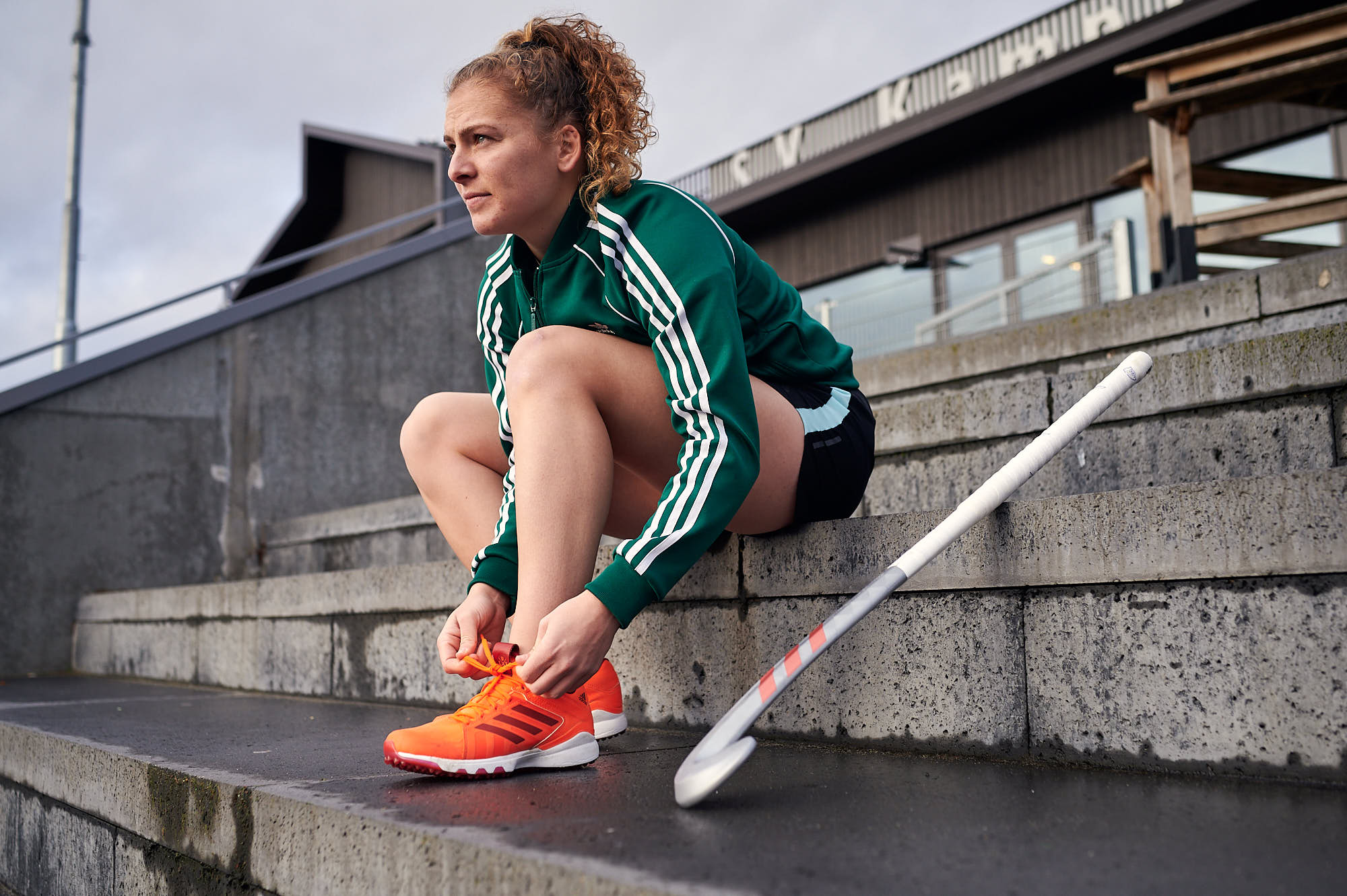 Portrait of hockey player Hester van der Veld, tying shoelaces
