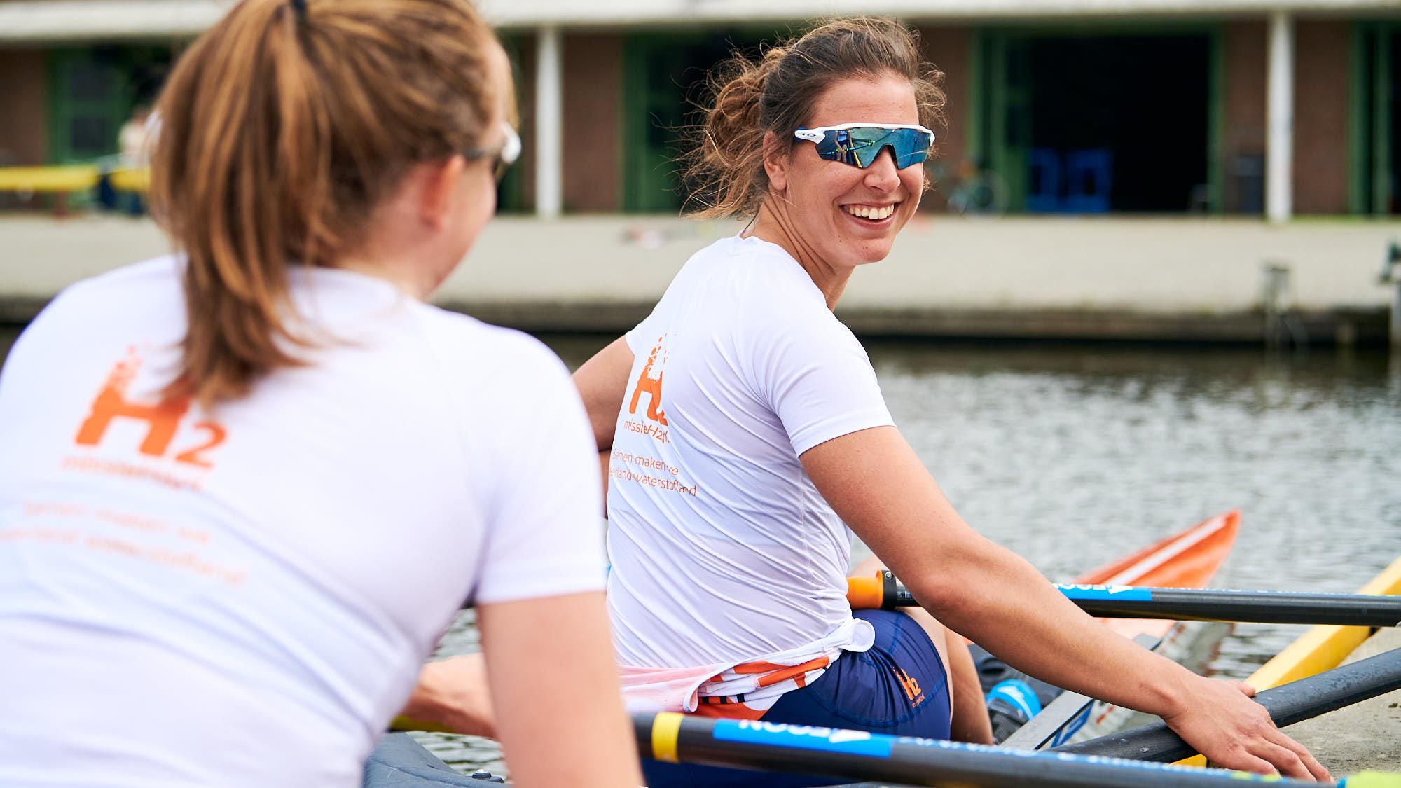 Ilse Paulis and Marieke Keijser lifestyle shot in rowing boat