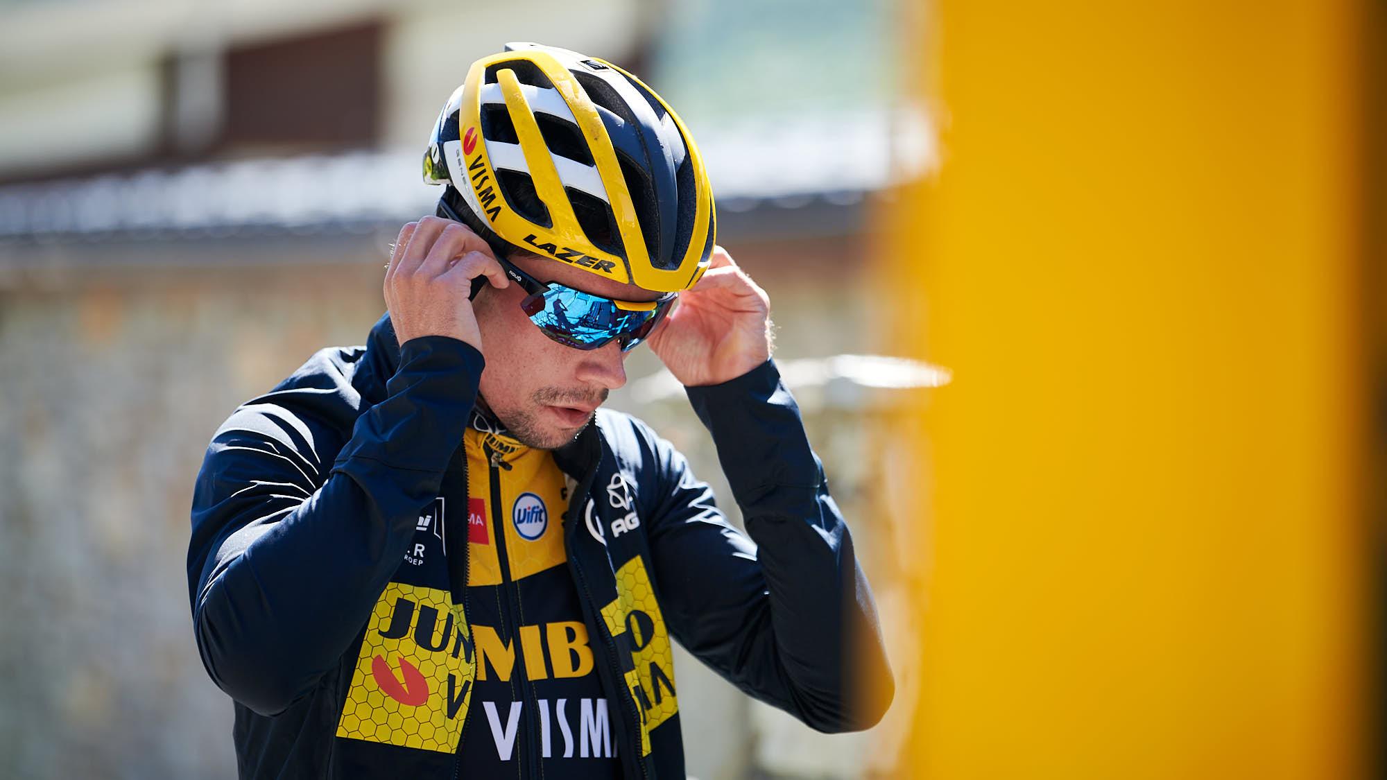 Primoz Roglic putting on glasses